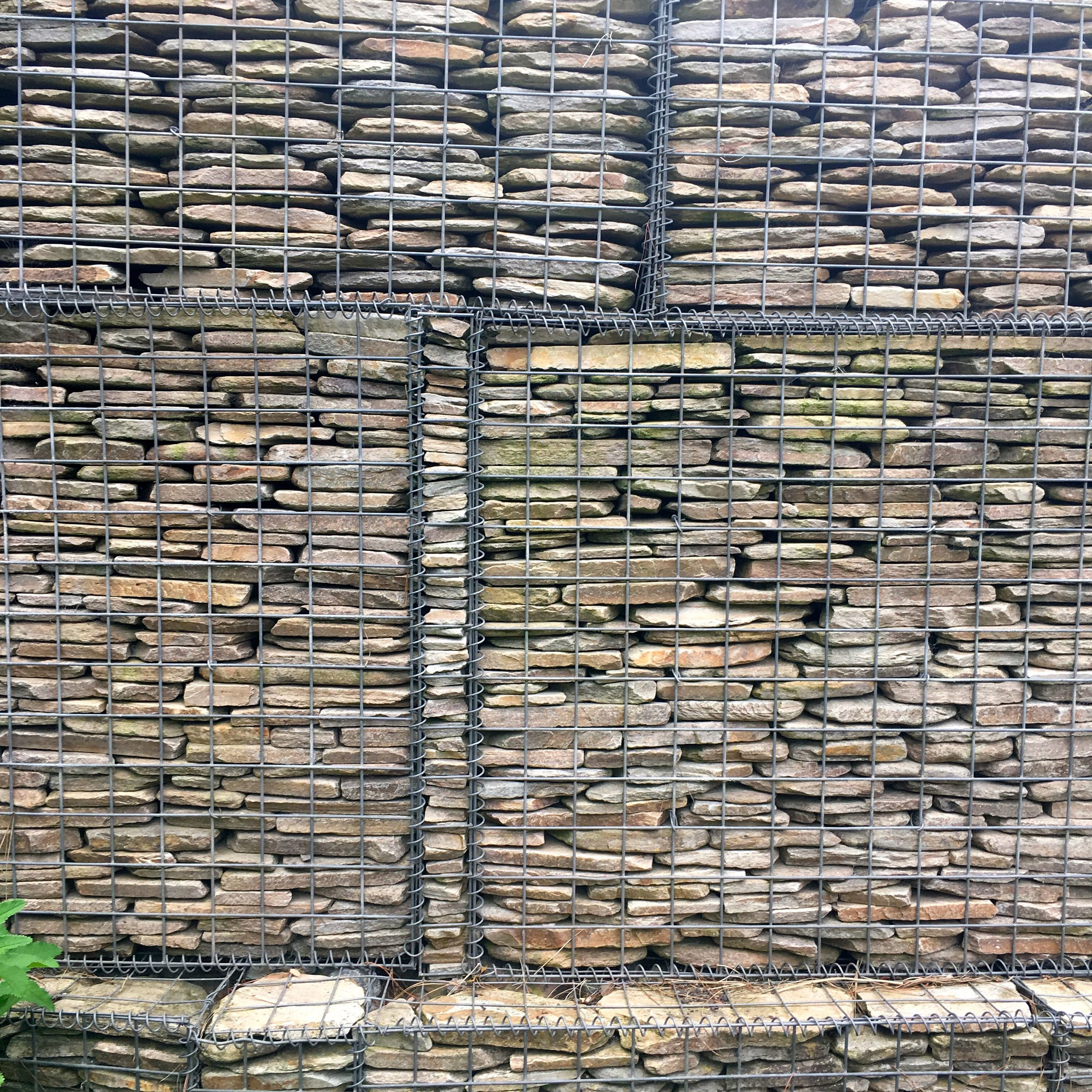 NEATLY STACKED GABION BASKETS IN THE ROBINSONS GARDEN