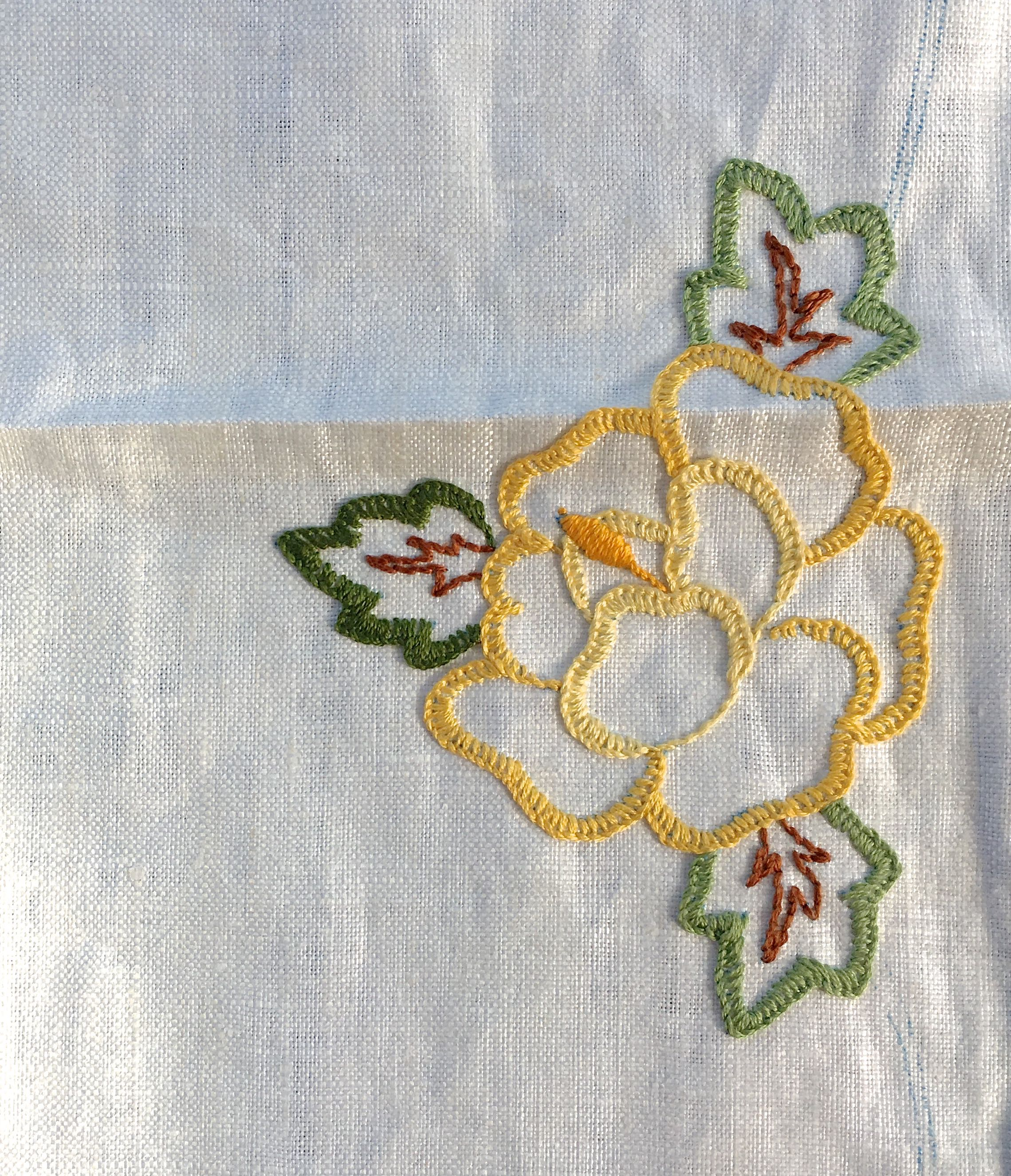 My linen tablecloth embroidery project - a completed yellow rose
