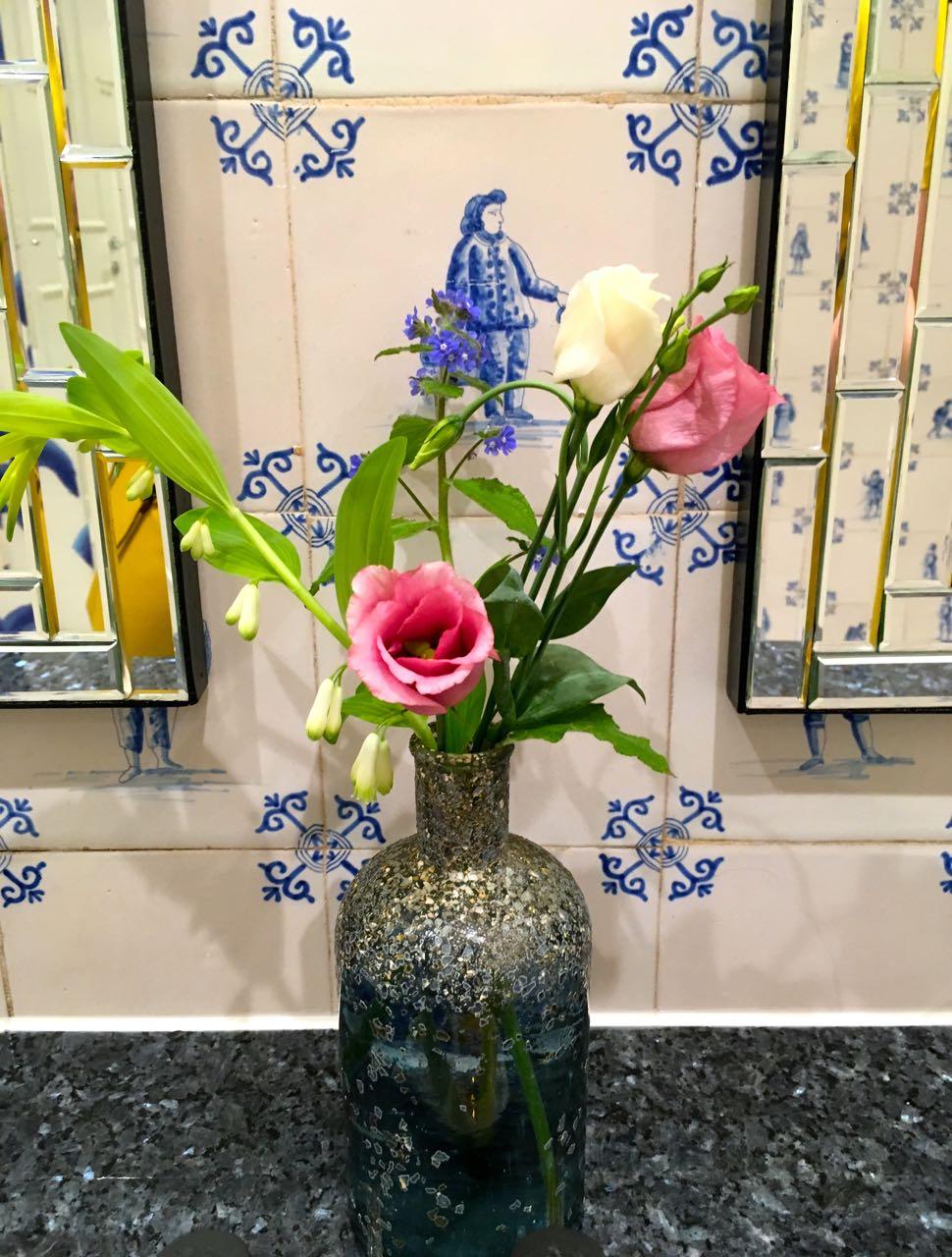 Roses and pretty tiles  in the Ladies at Gravetye Manor