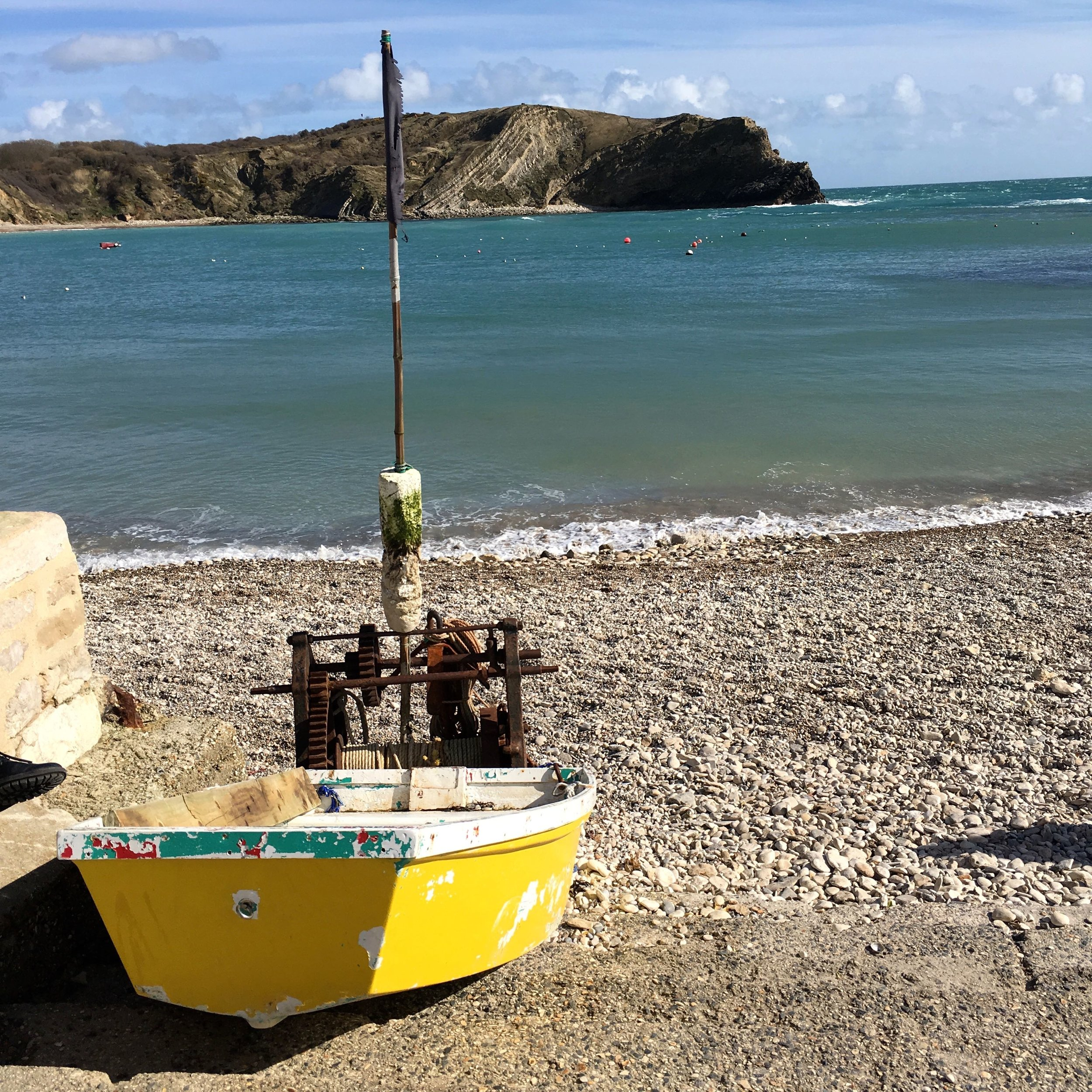 BLUE SKIES, BLUE SEA AND A DINKY YELLOW BOAT