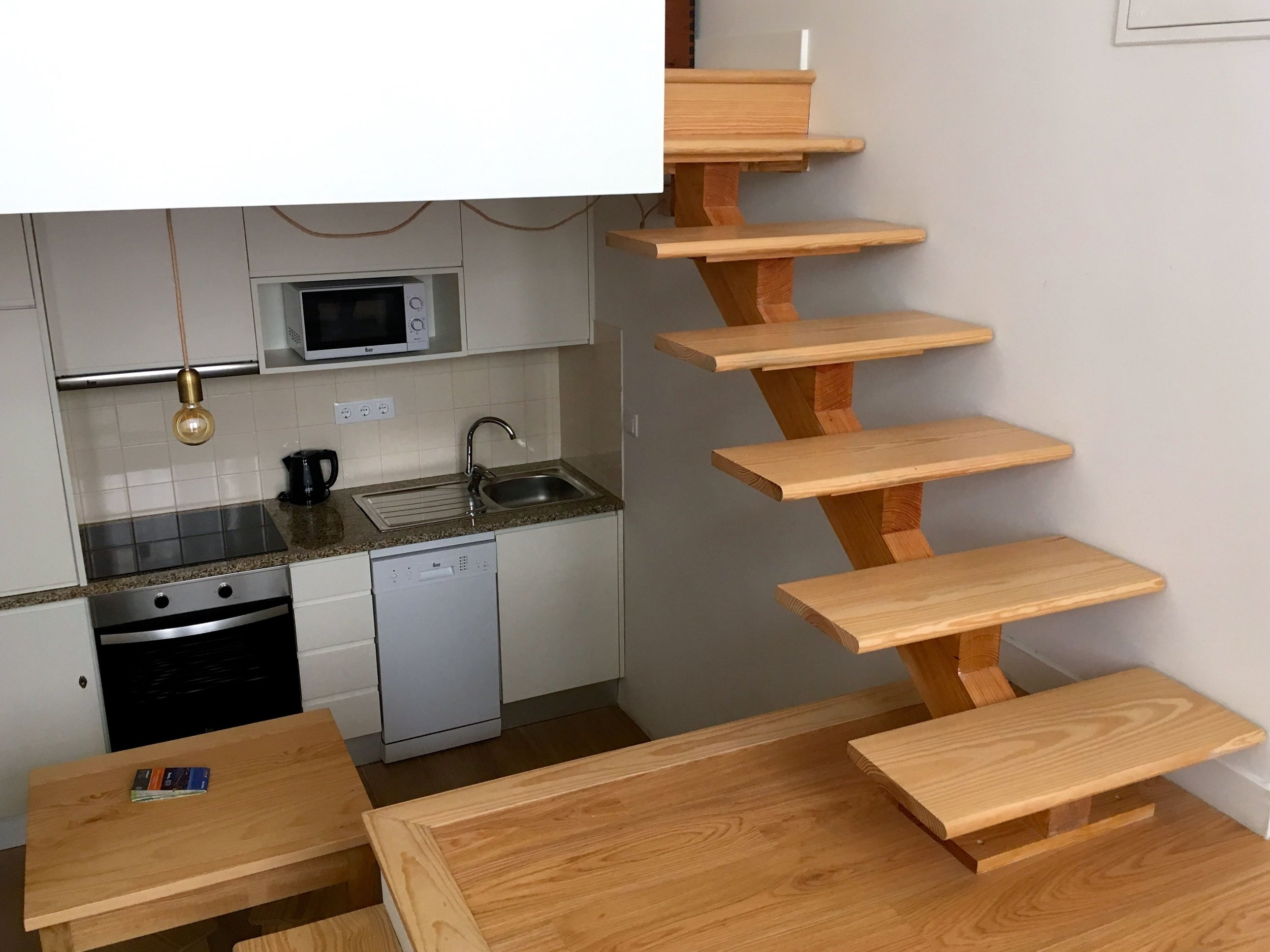 Upstairs to the bedroom and downstairs to the kitchen