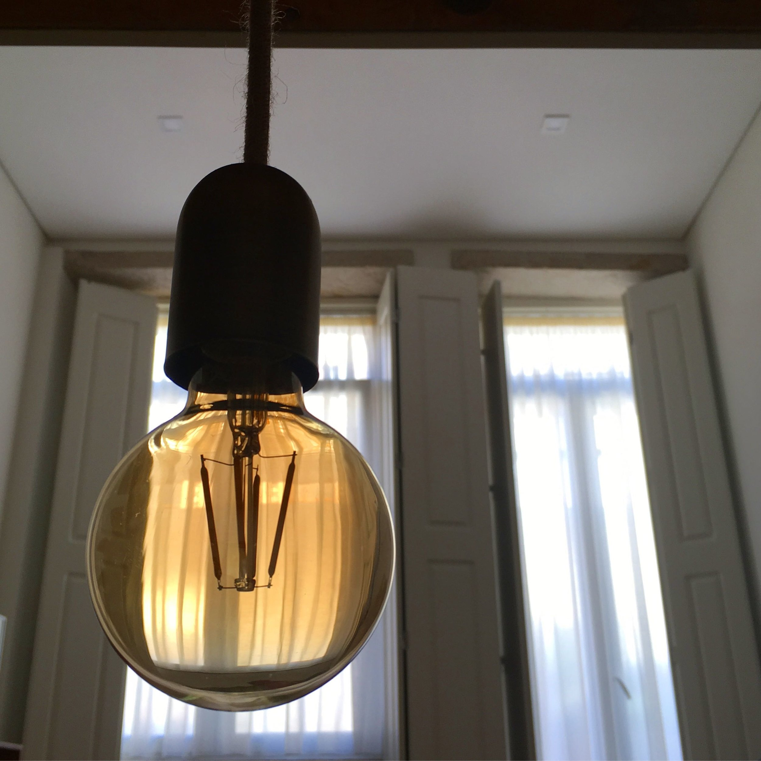 More great lights in the kitchen in the quirky apartment in Porto's Bomfim