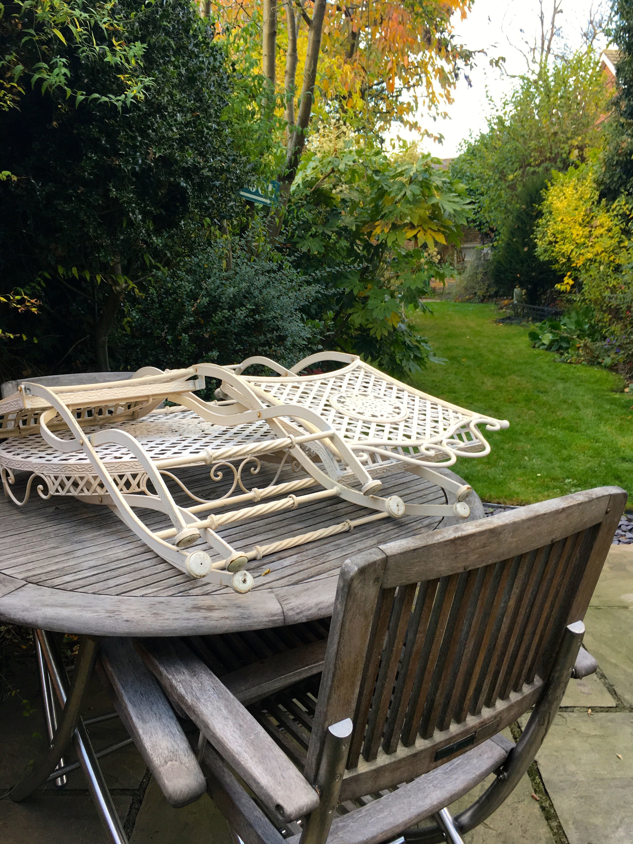 Stacking the garden furniture before covering with a tarpaulin