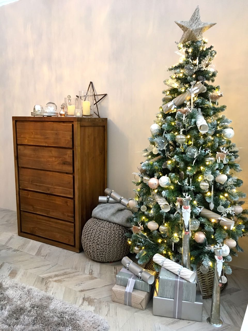 A tallboy and a Christmas tree too  in this room set at the Ideal Home Show at Christmas