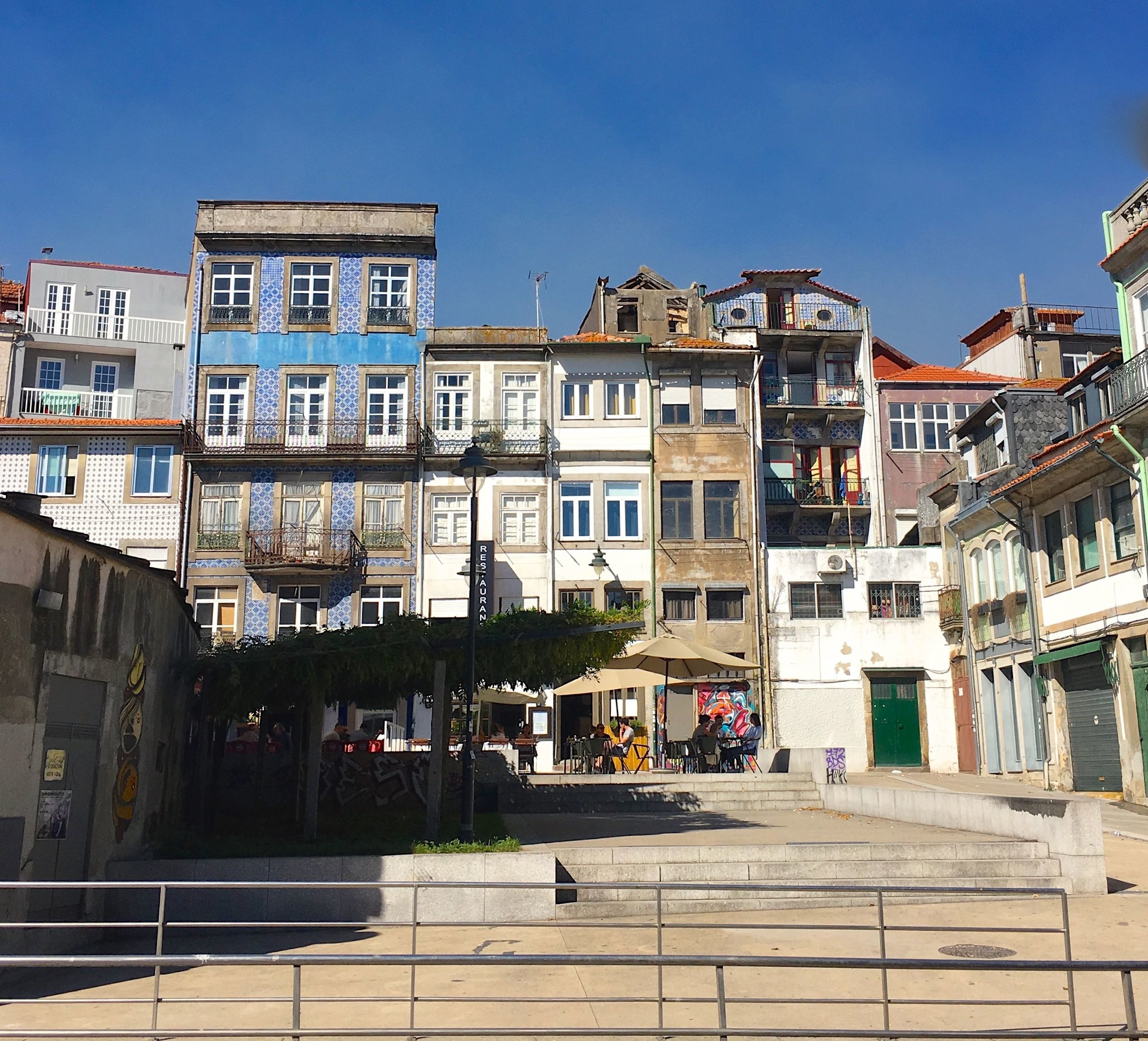multi-storied buildings in porto with some interesting roof additions
