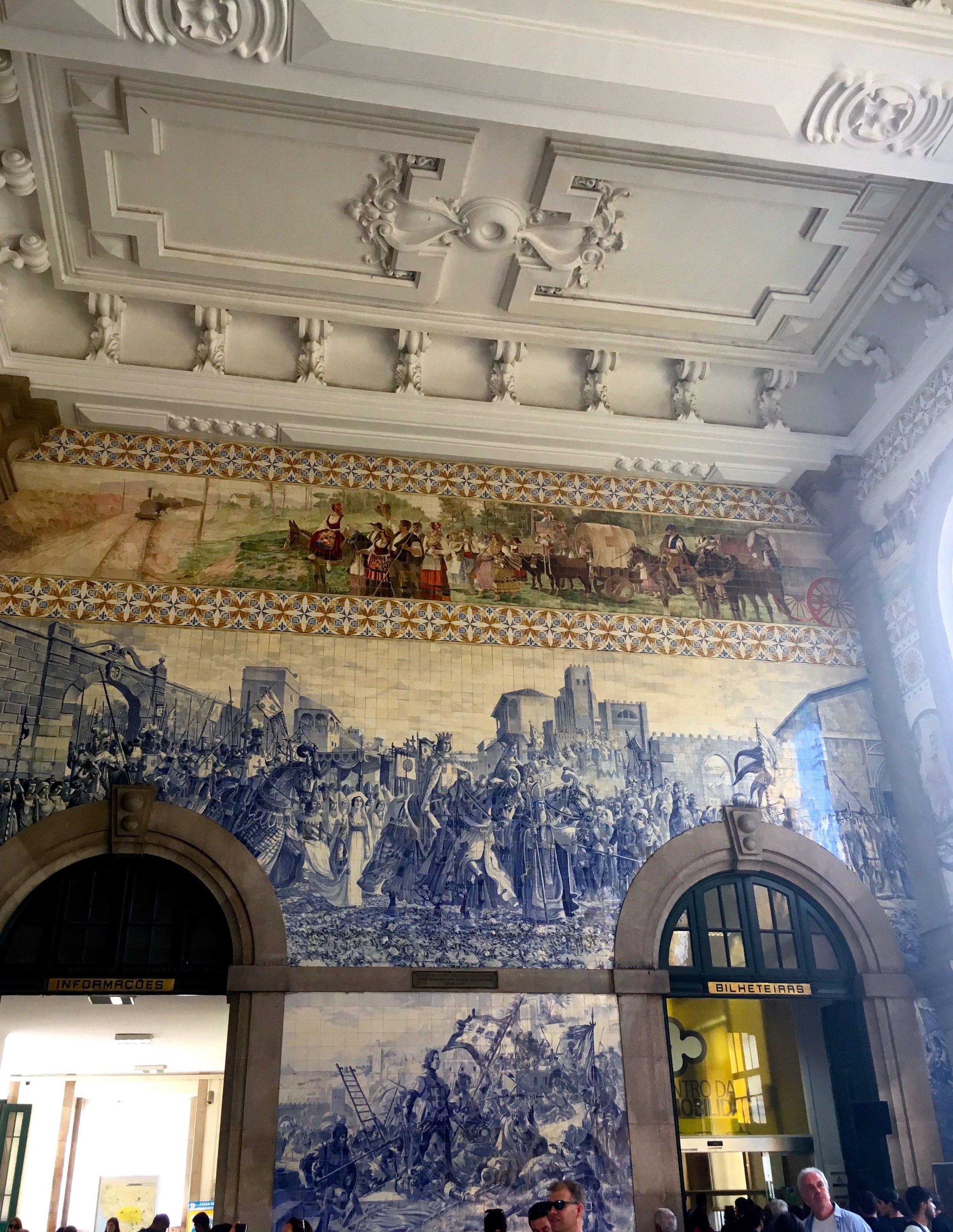 a highly decorative sao bento station in porto