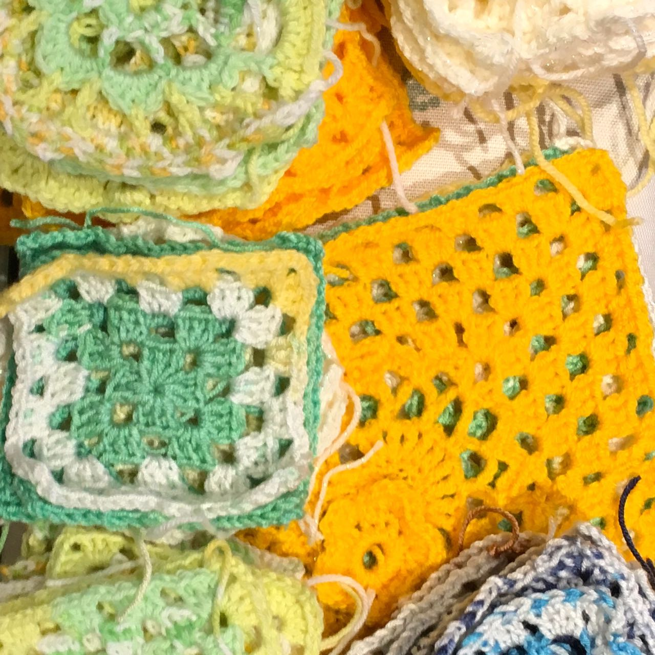 granny squares in yellows greens and blues