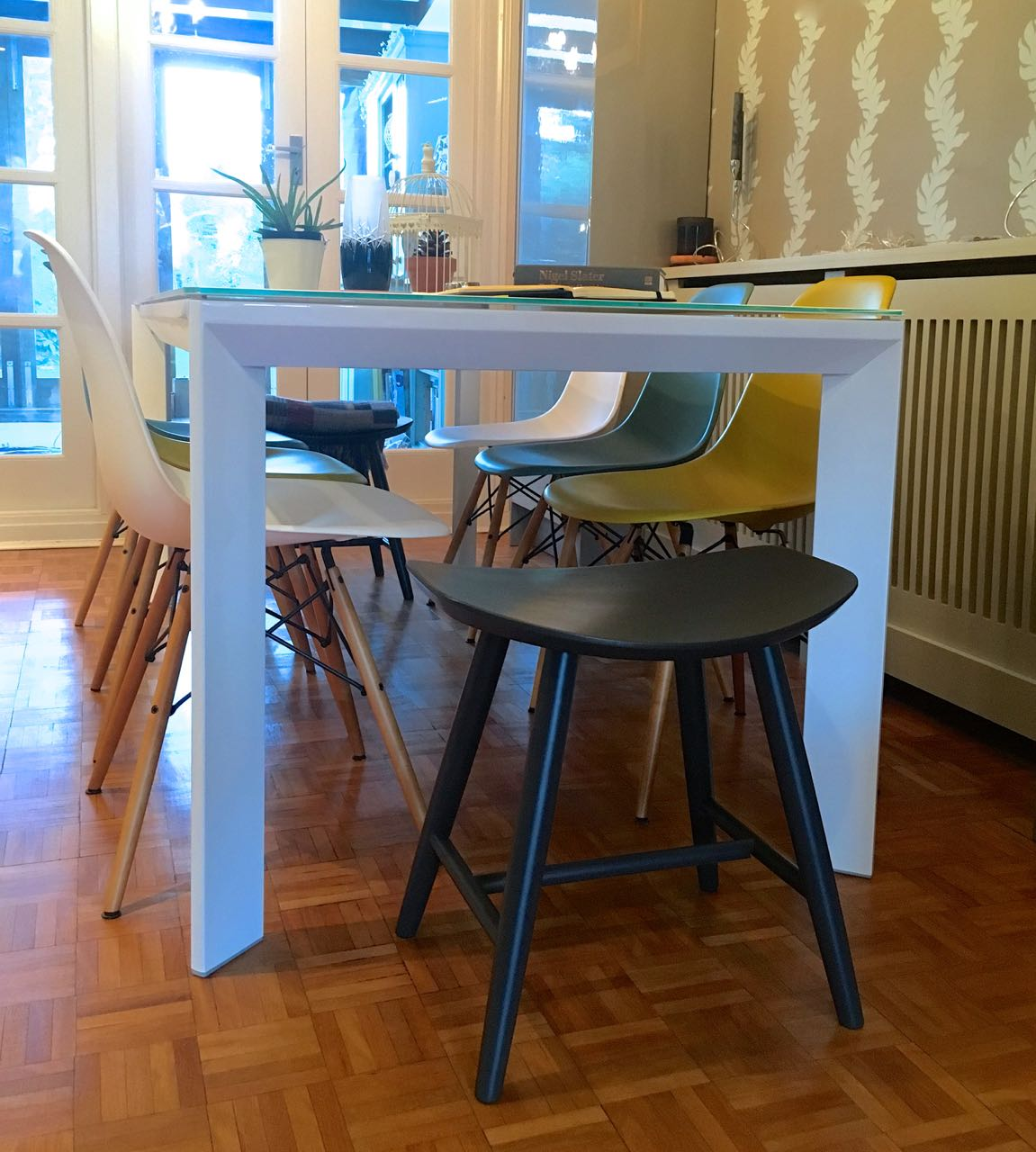 With the table extended the stools are better at each end