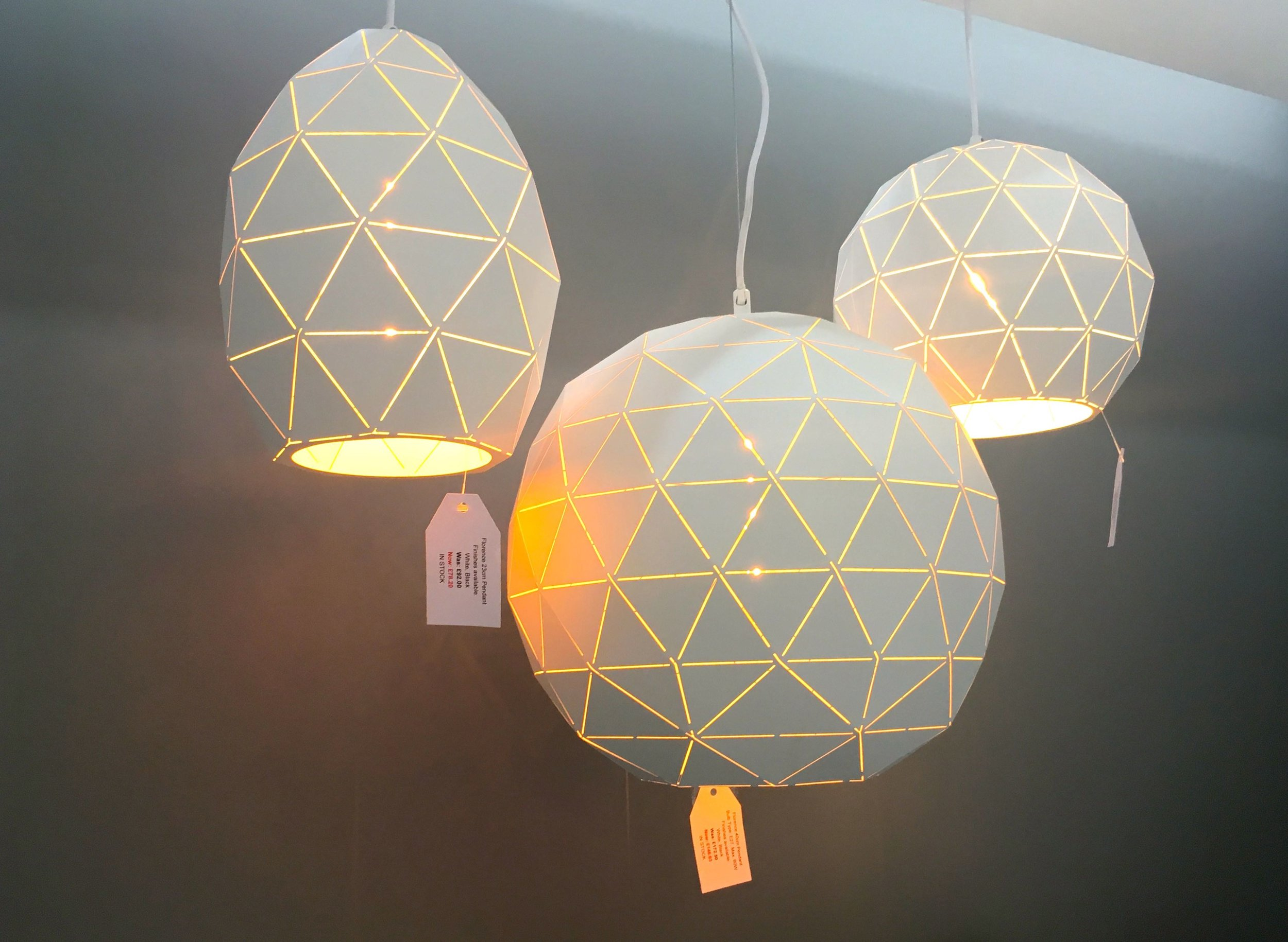 Geometric lights on the Furnish your home stand at the Ideal Home Show