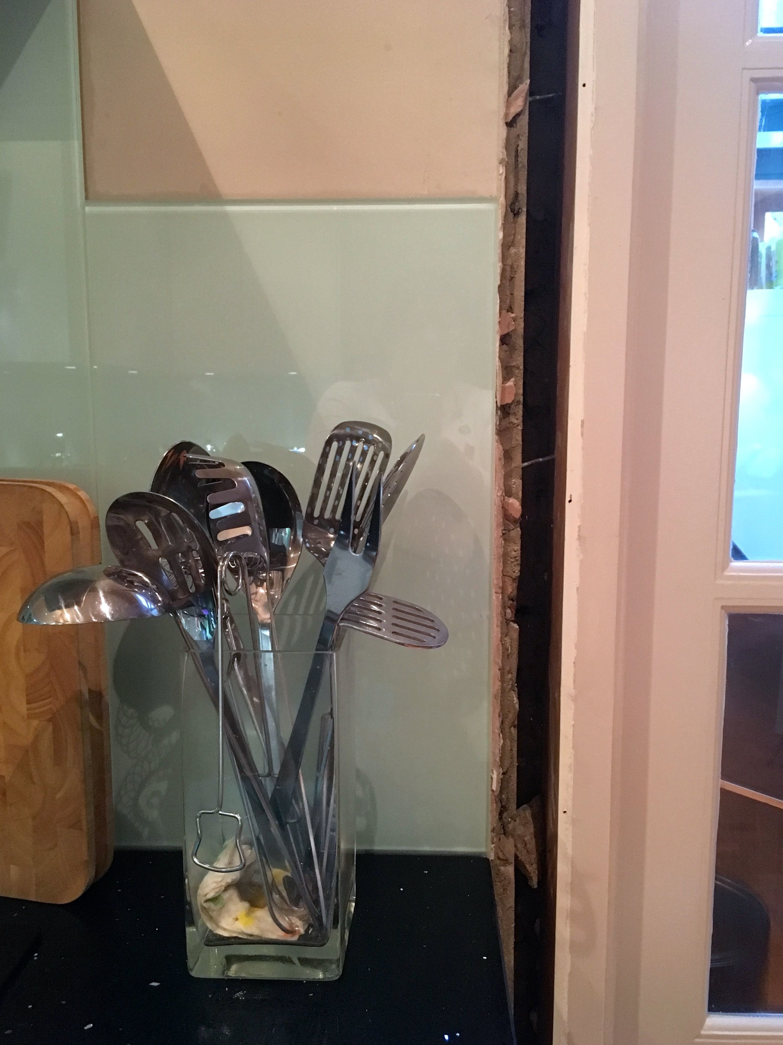 The architrave's off and the glass splashback unharmed