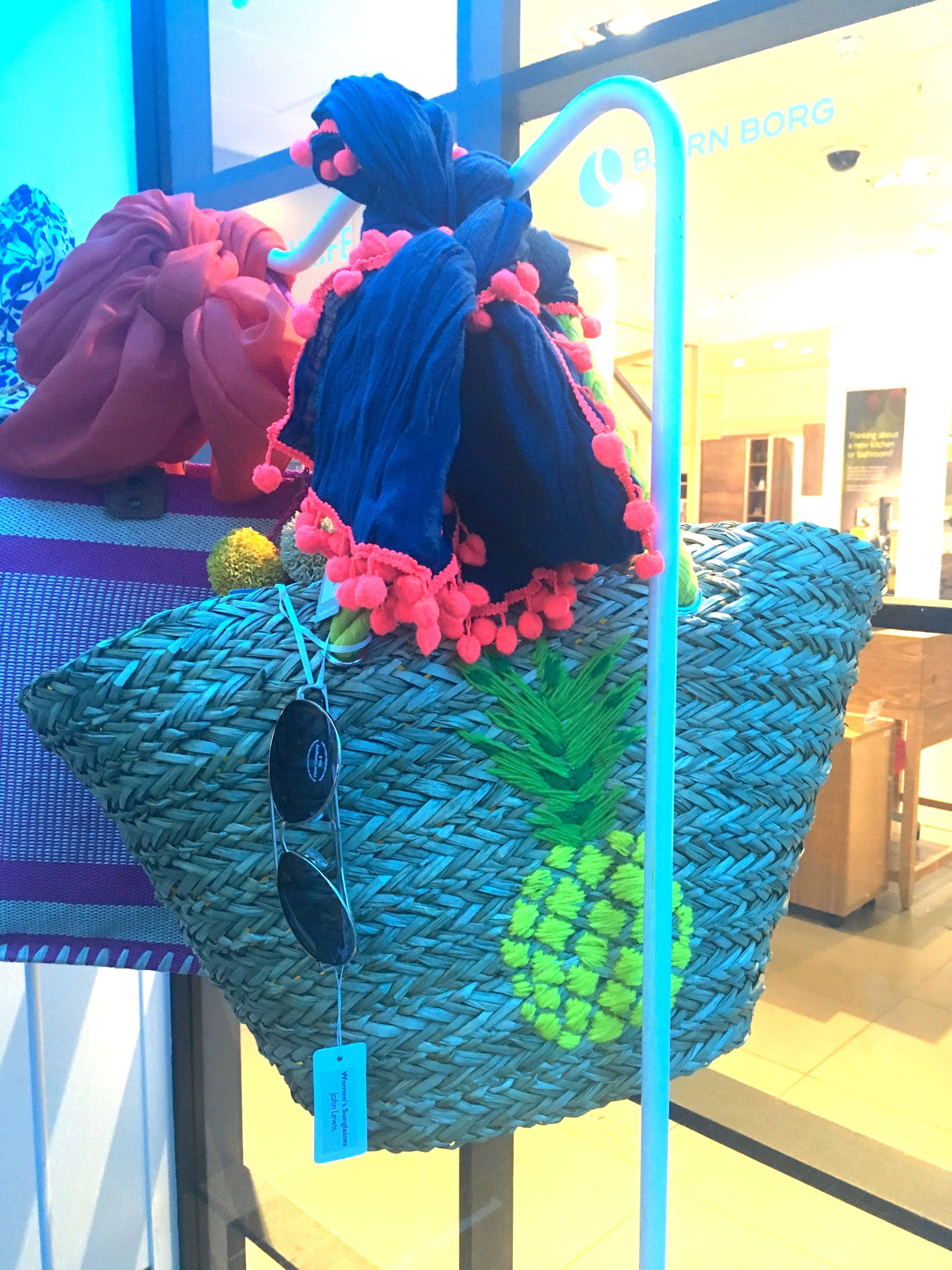pineapples on straw beach bags, and a pom-pom edged sarong
