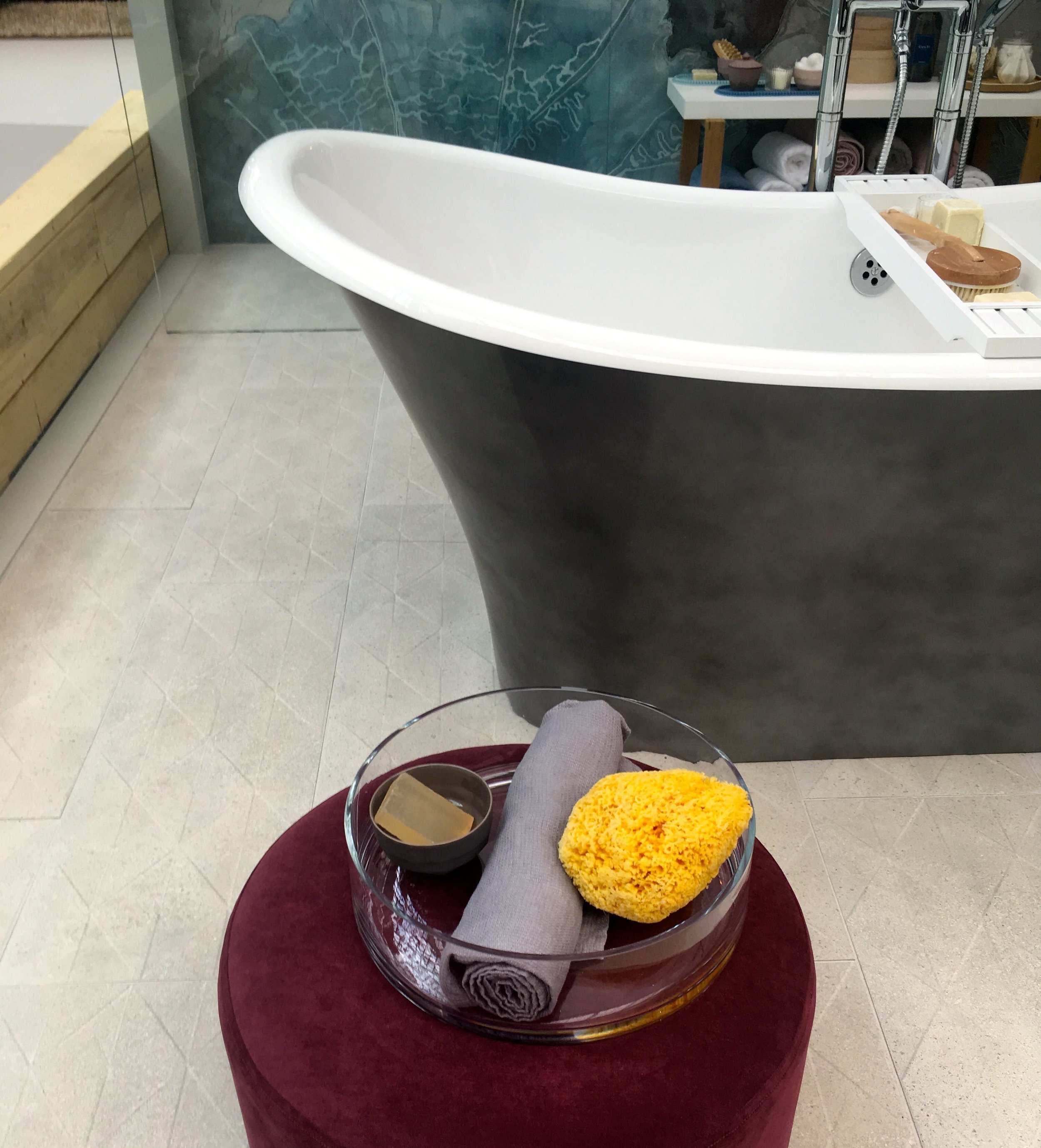 A free standing bath and some pamper items