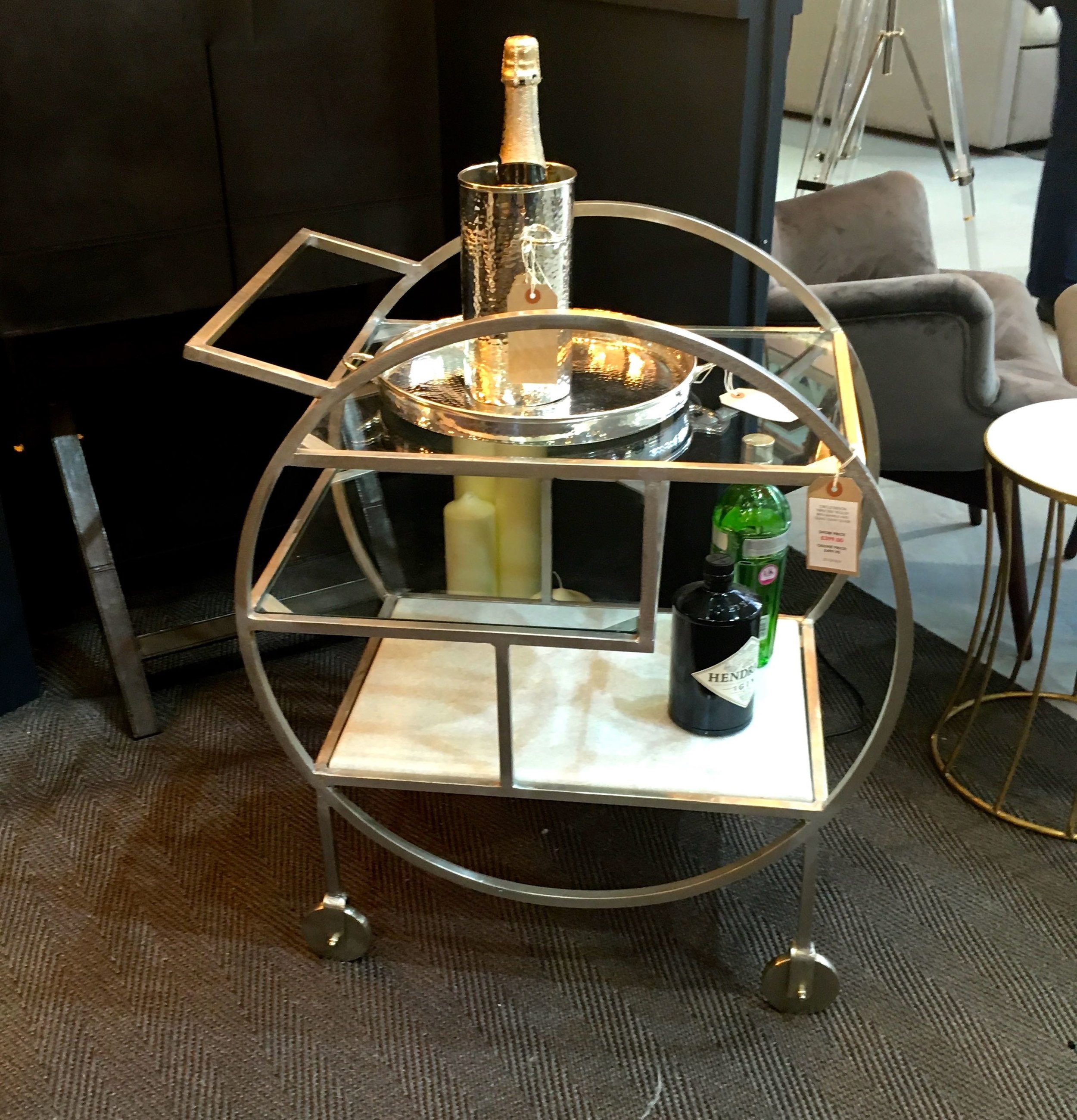 An art deco style drinks trolley