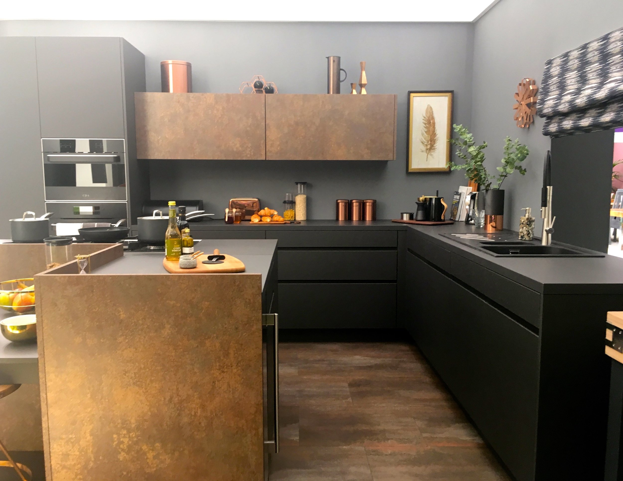 dark greys and earthy tones in this dramatic kitchen at the ideal home show