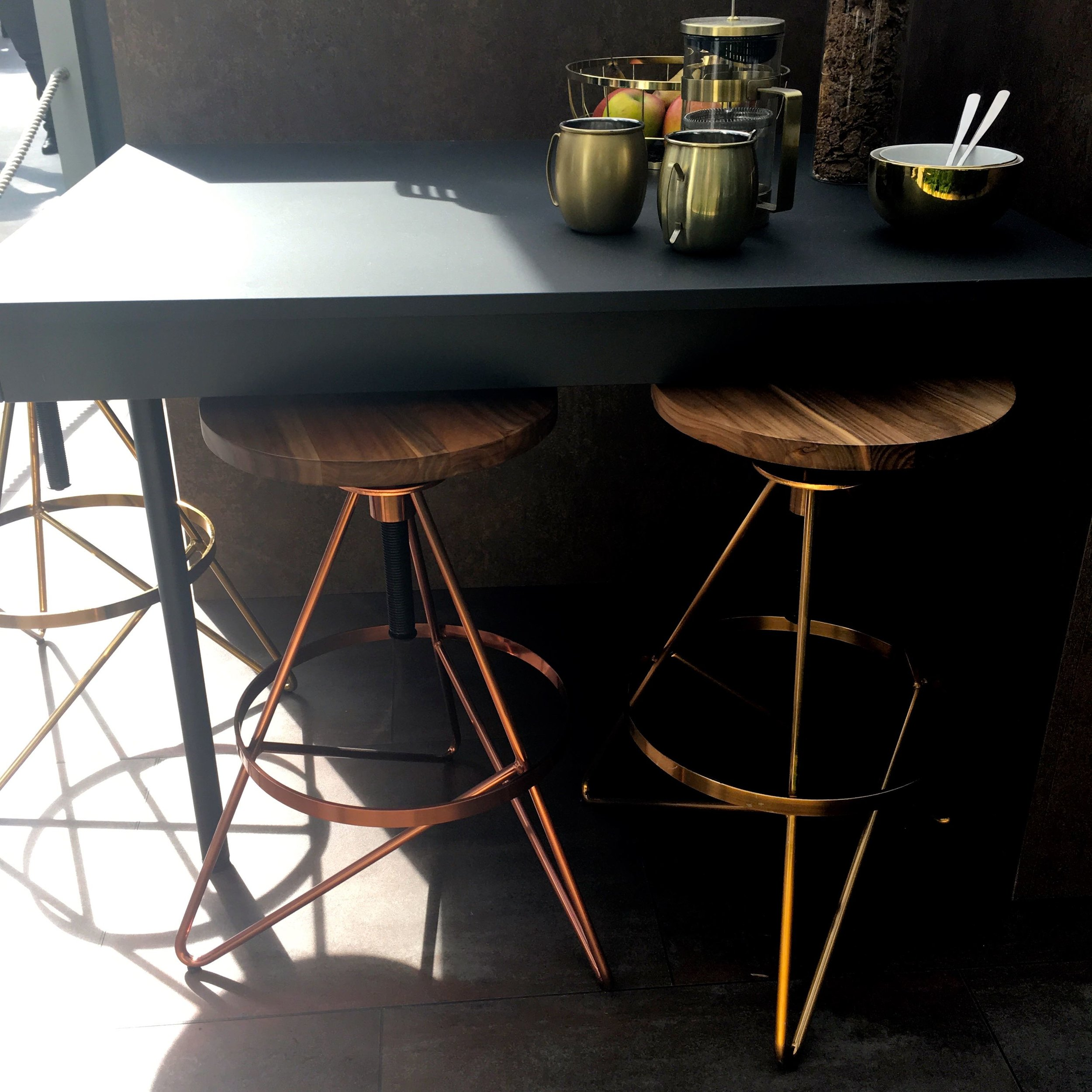 Copper and wood stools nestled under the breakfast bar