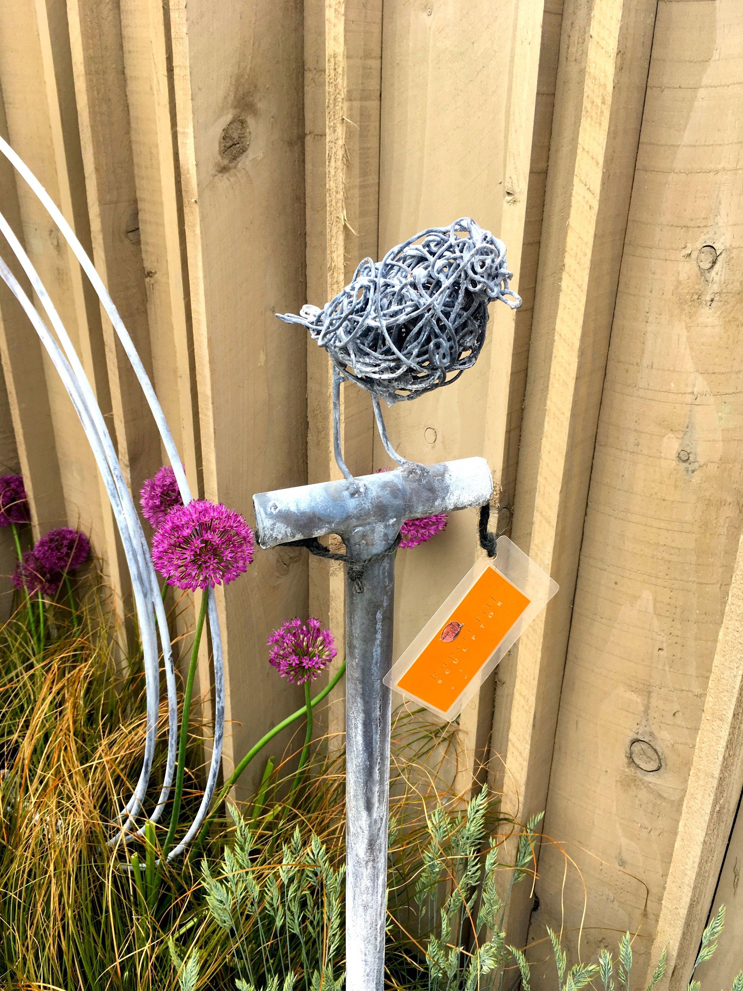 A wire robin on a spade by Robert Till