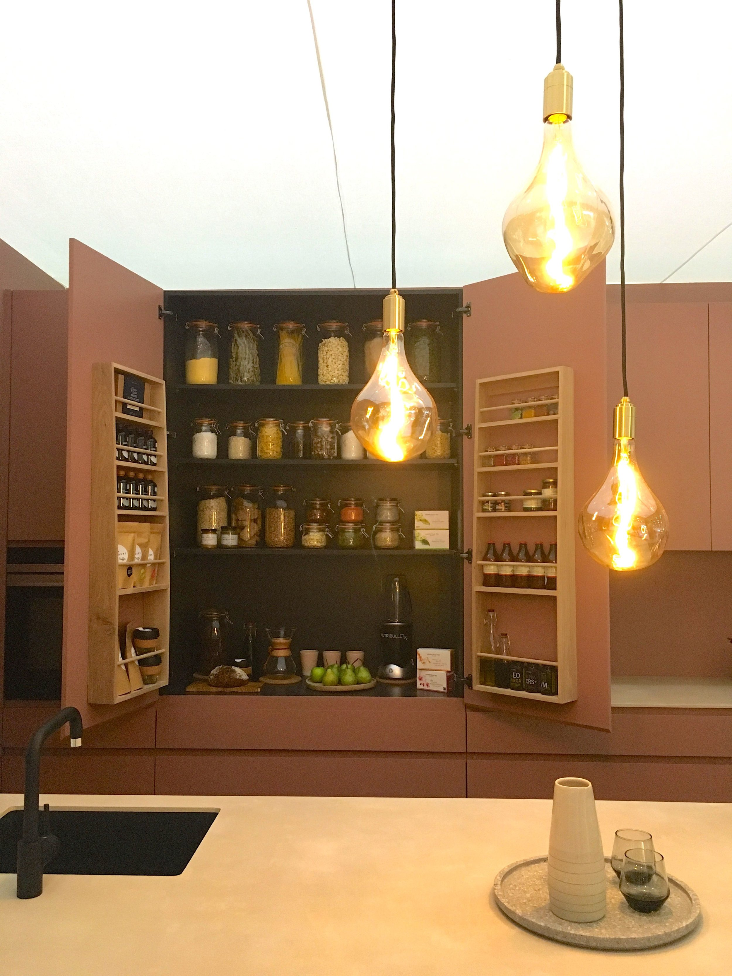 A peek into the cupboards at this roomset at Grand Designs