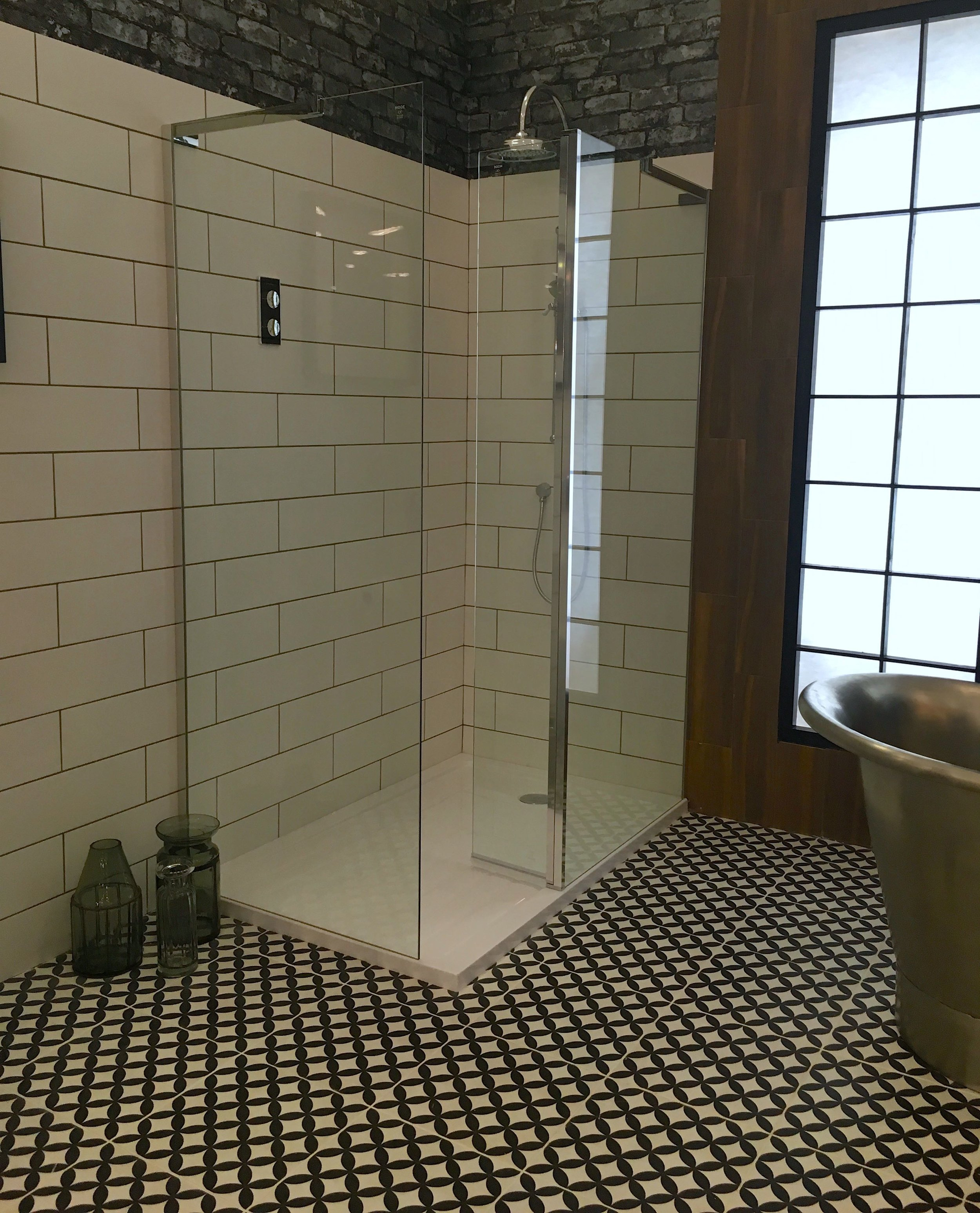 A frameless glass walk in shower