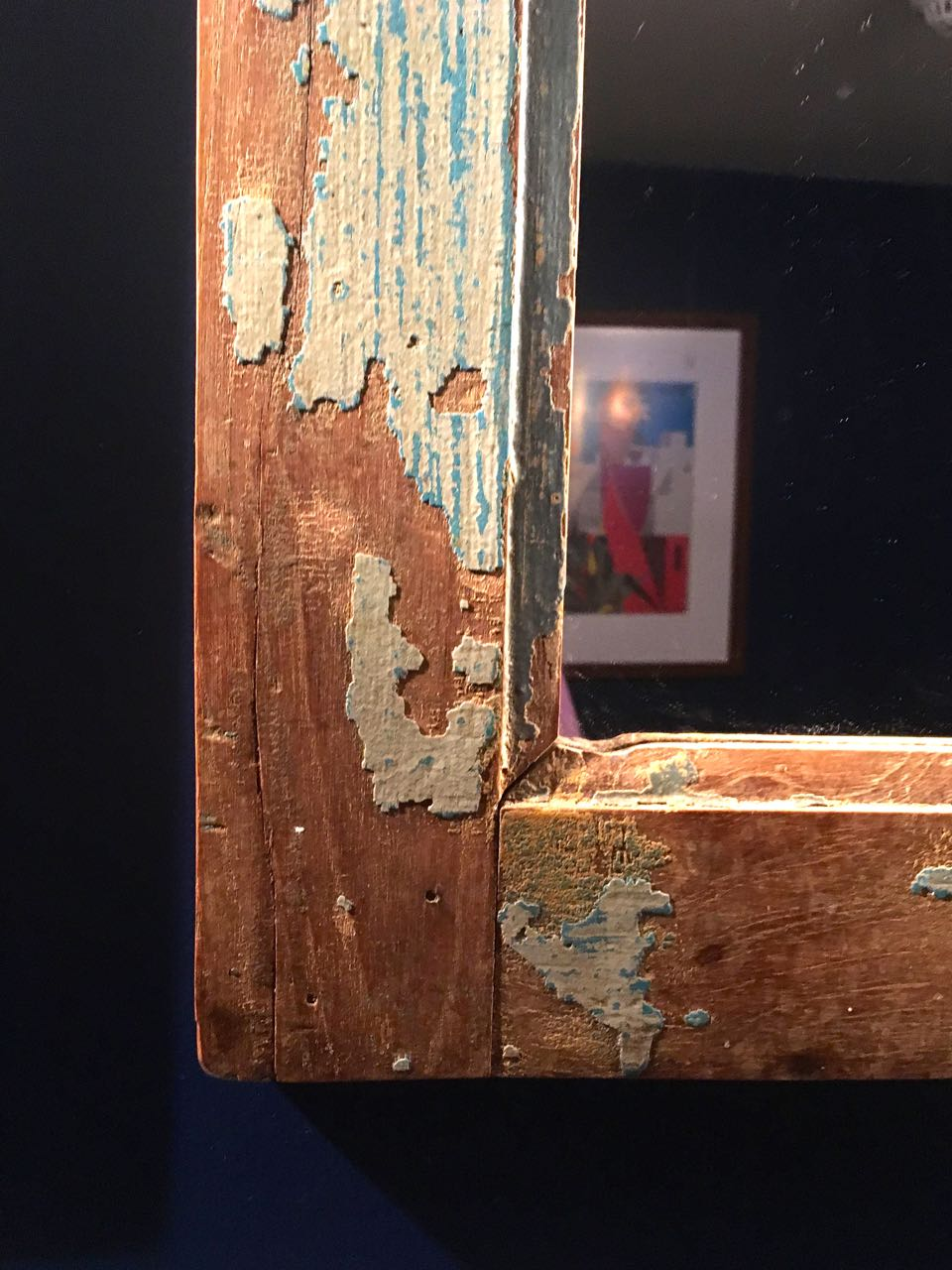 A textured corner of a picture frame