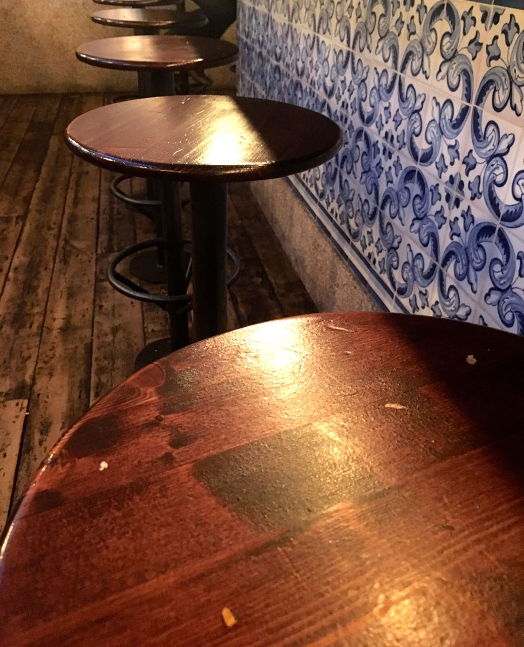 Stools lined up against the tile clad counter