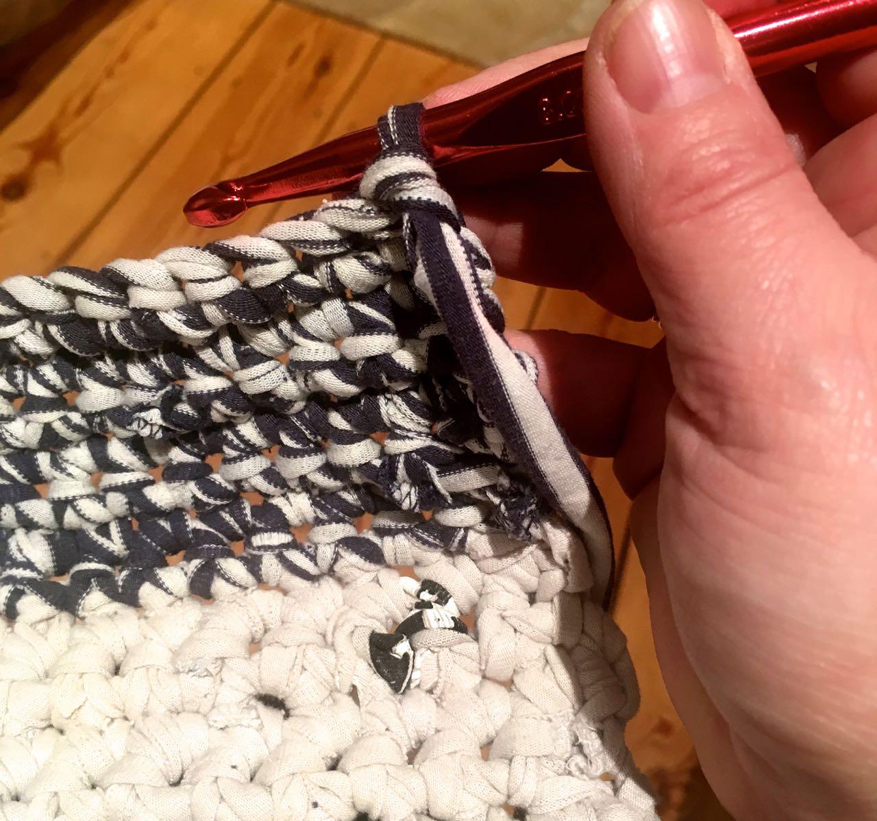 stripey yarn on my crochet basket