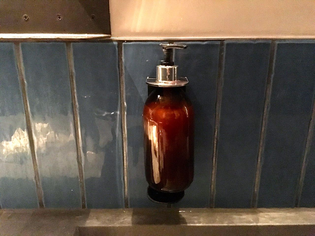A closer look at the tiles and soap dispensers