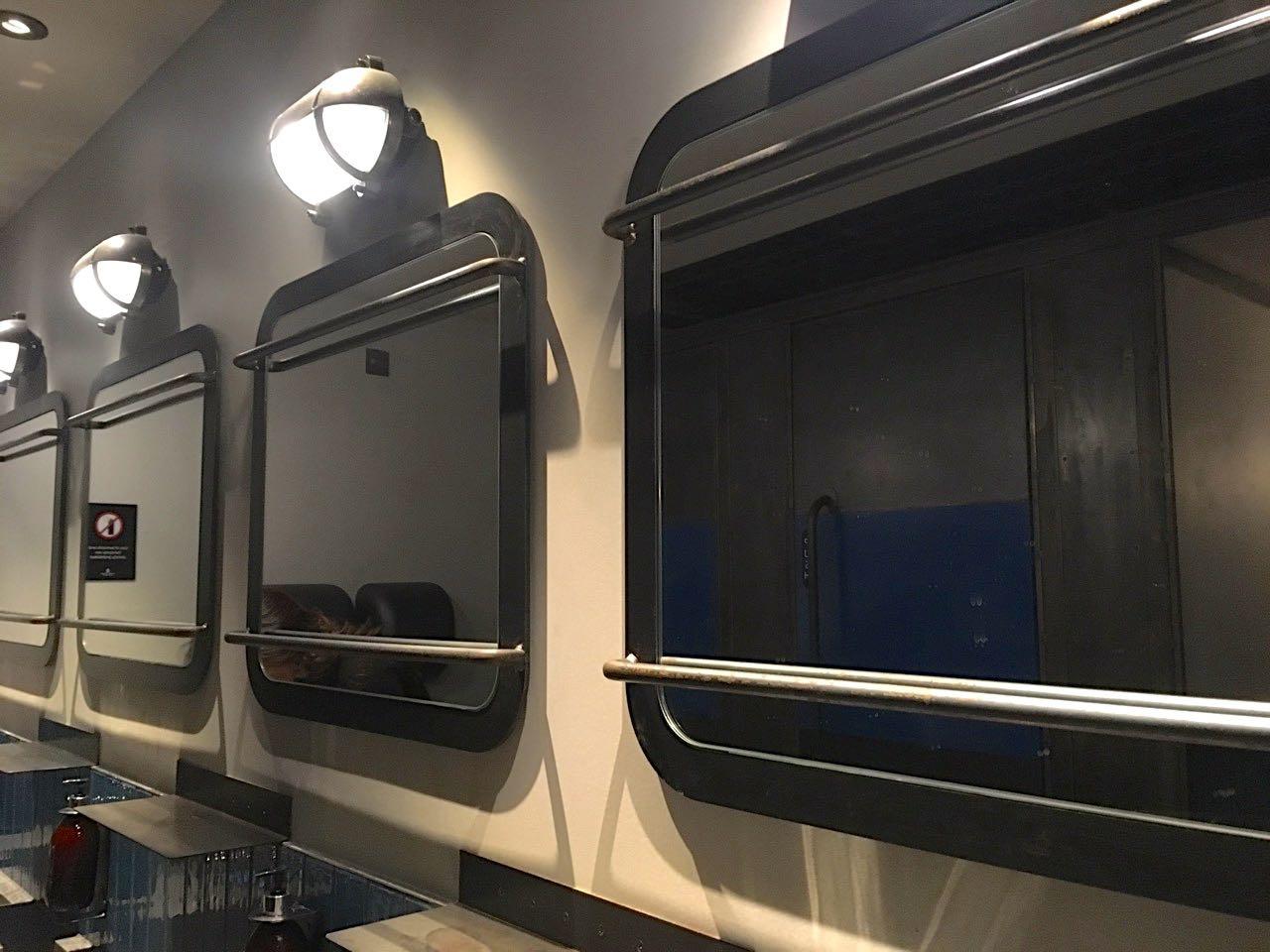 a row of uniform mirrors