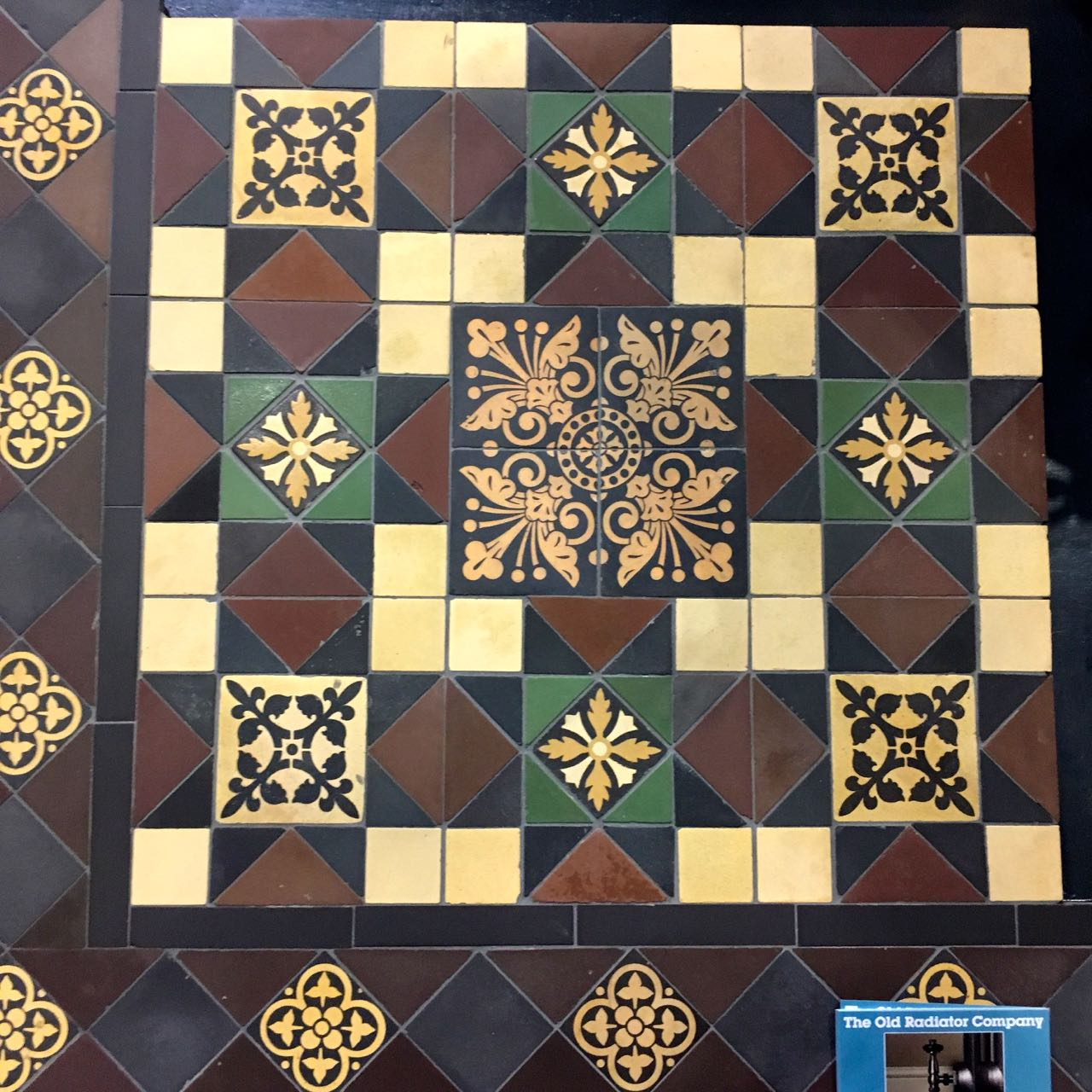 A traditional pattern using geometric and encaustic tiles