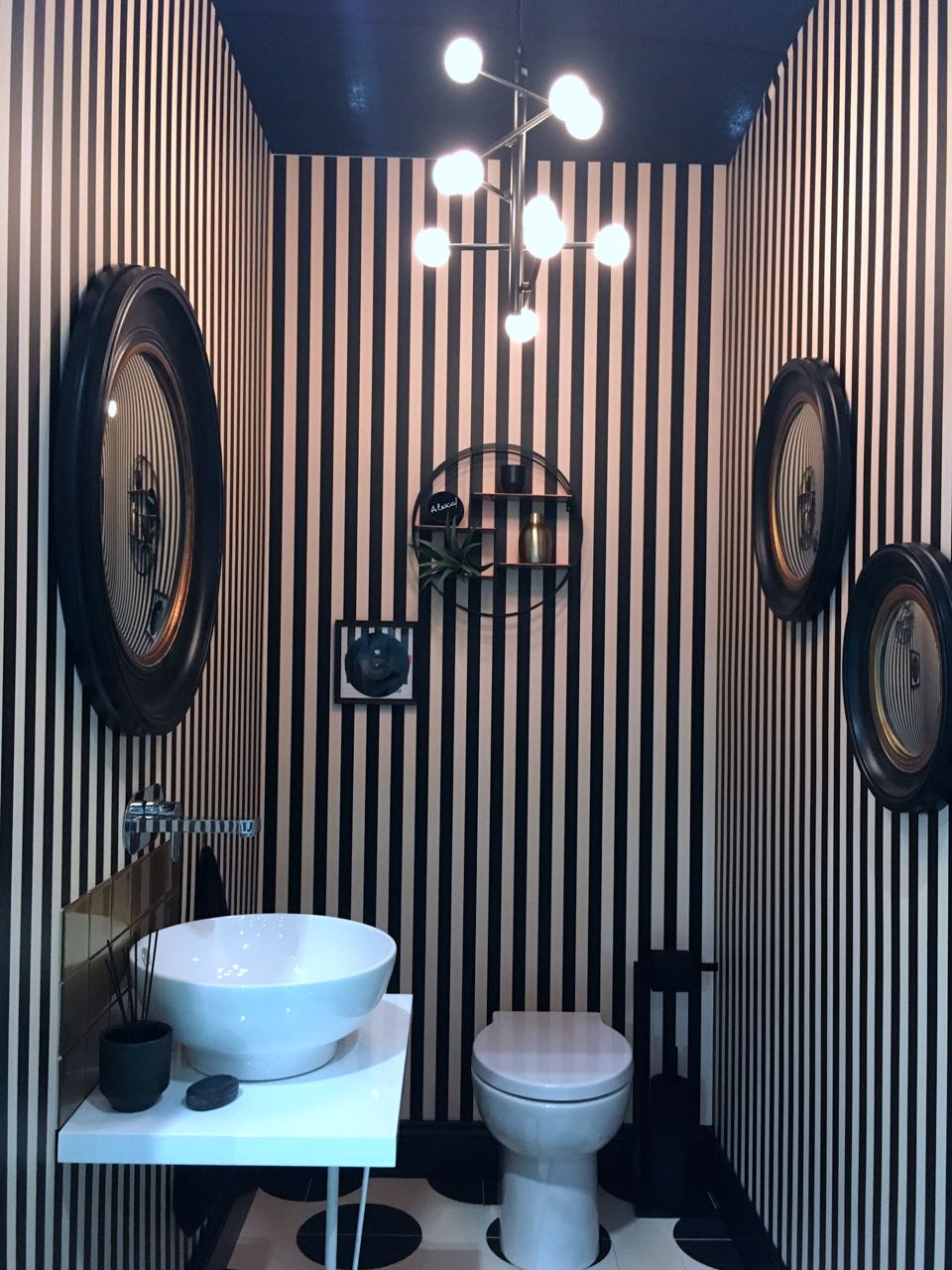 Black and white striped wallpaper for the lavatory project at Grand designs live
