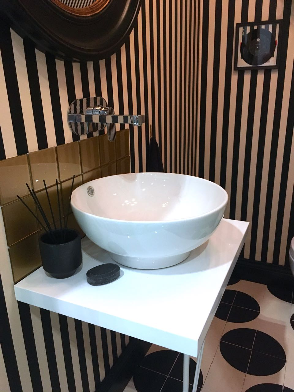 Spots stripes and a brilliant white washbasin