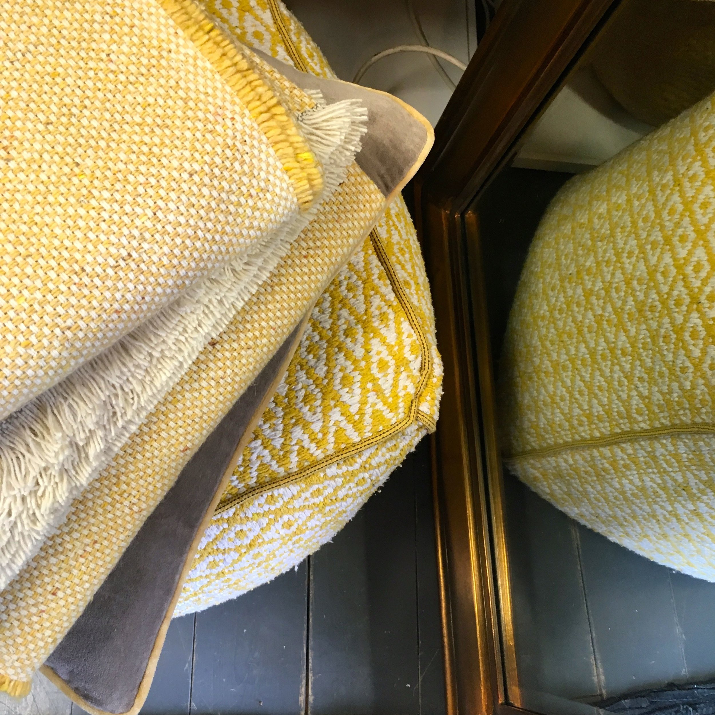 Textured blankets and pouffes
