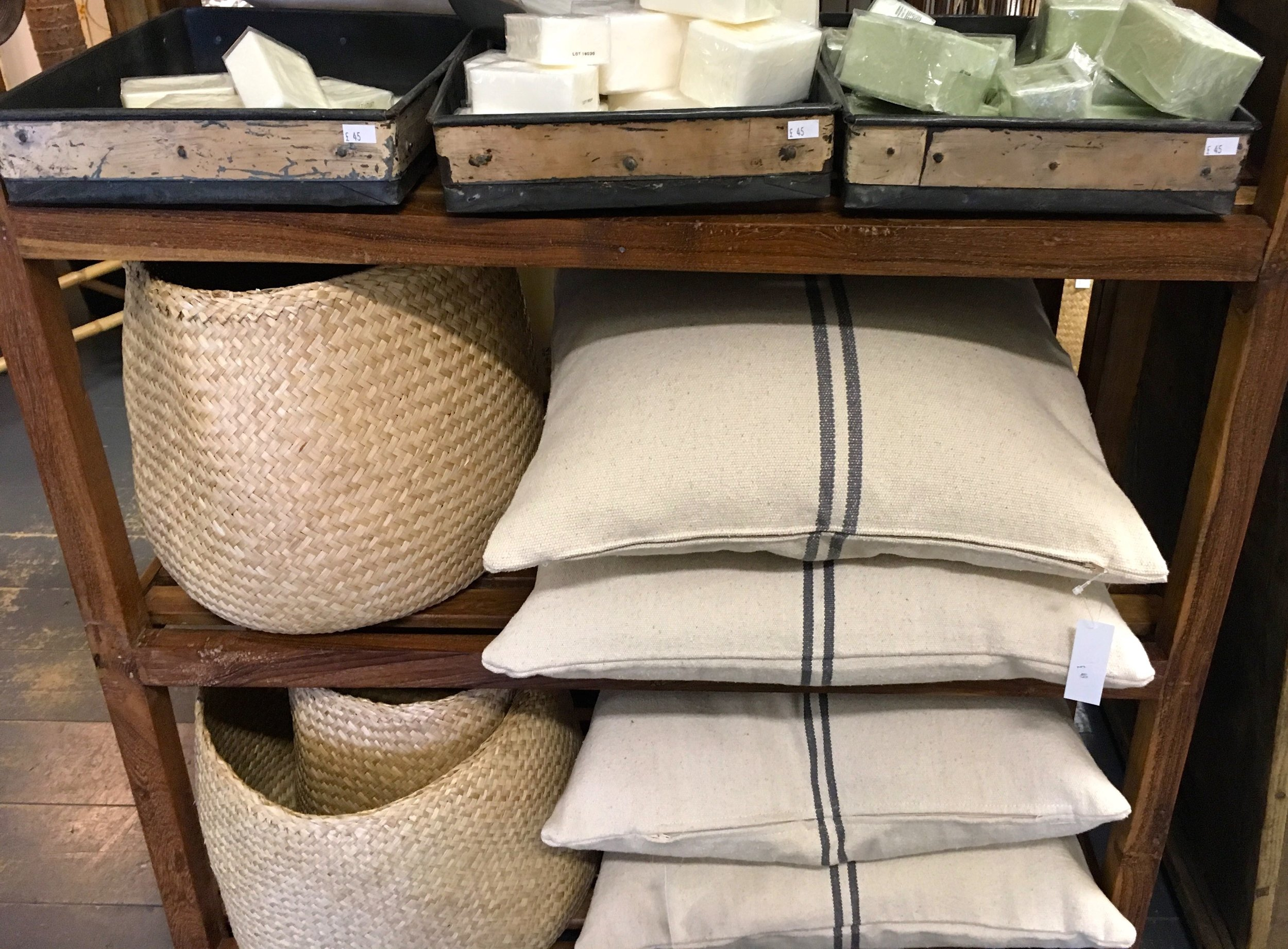 classic striped cushions and woven baskets