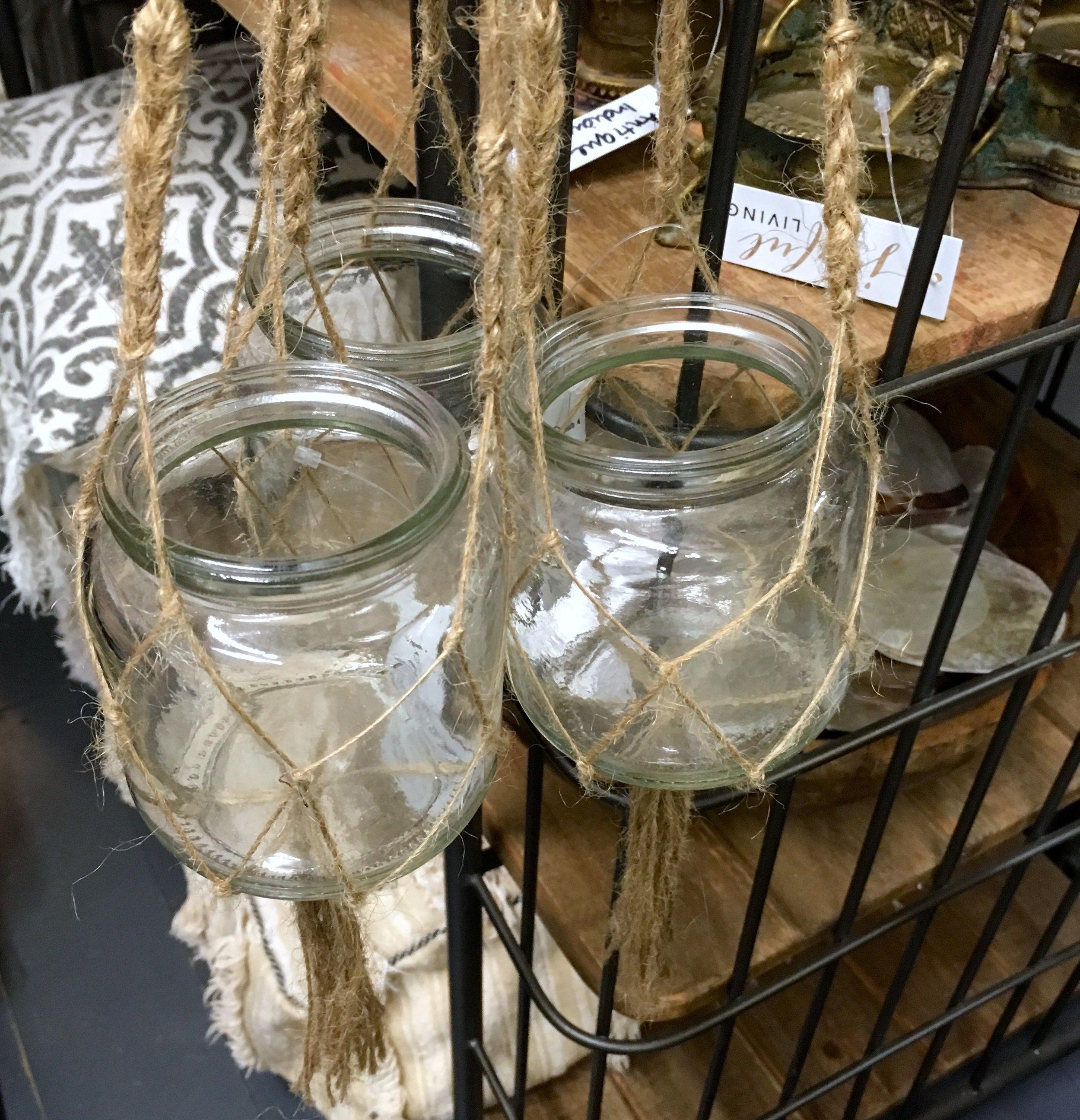 Glass jars hung in twine