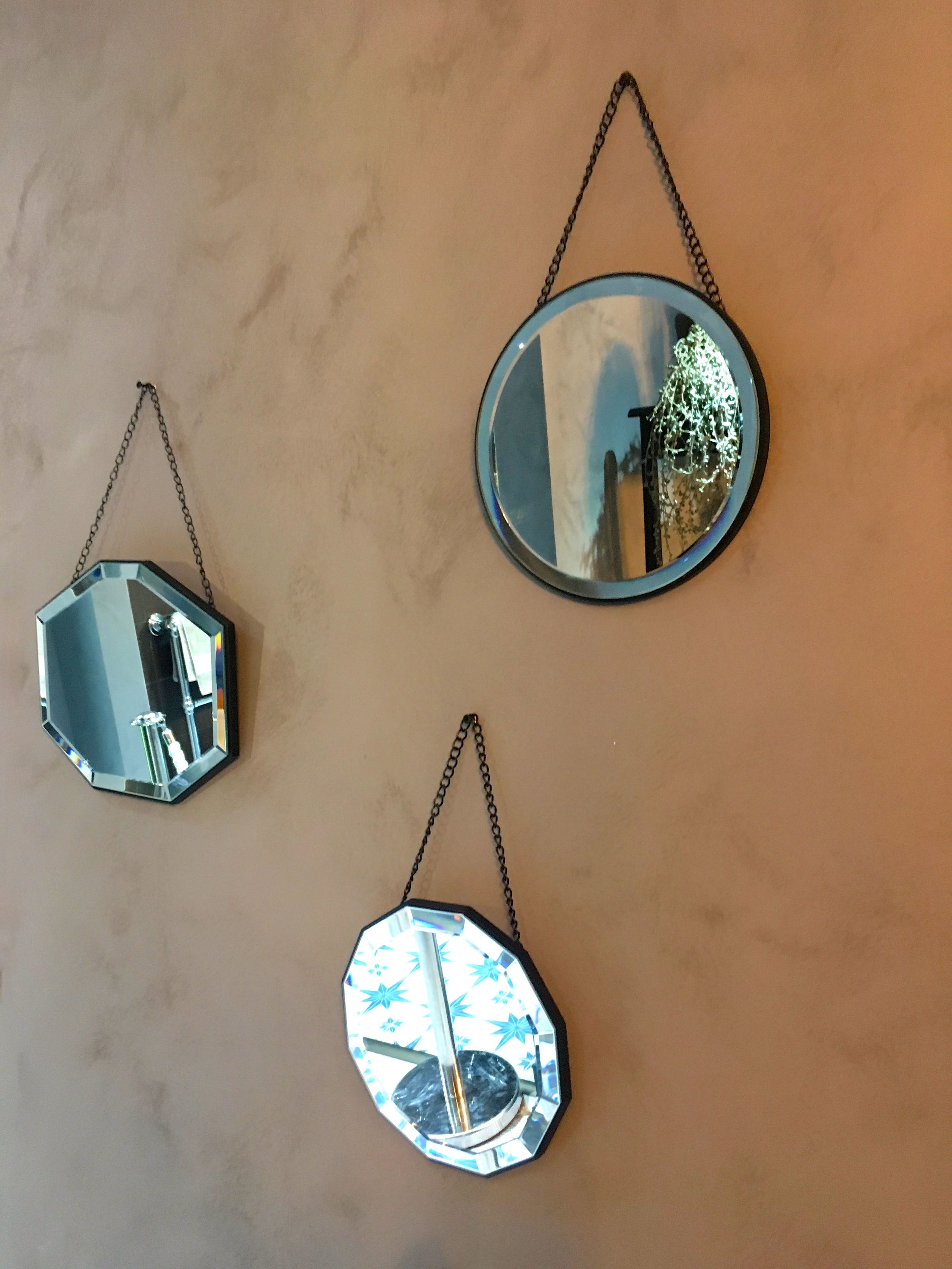 MIRRORS ON A PINK WALL IN THE EVOLVING HOME