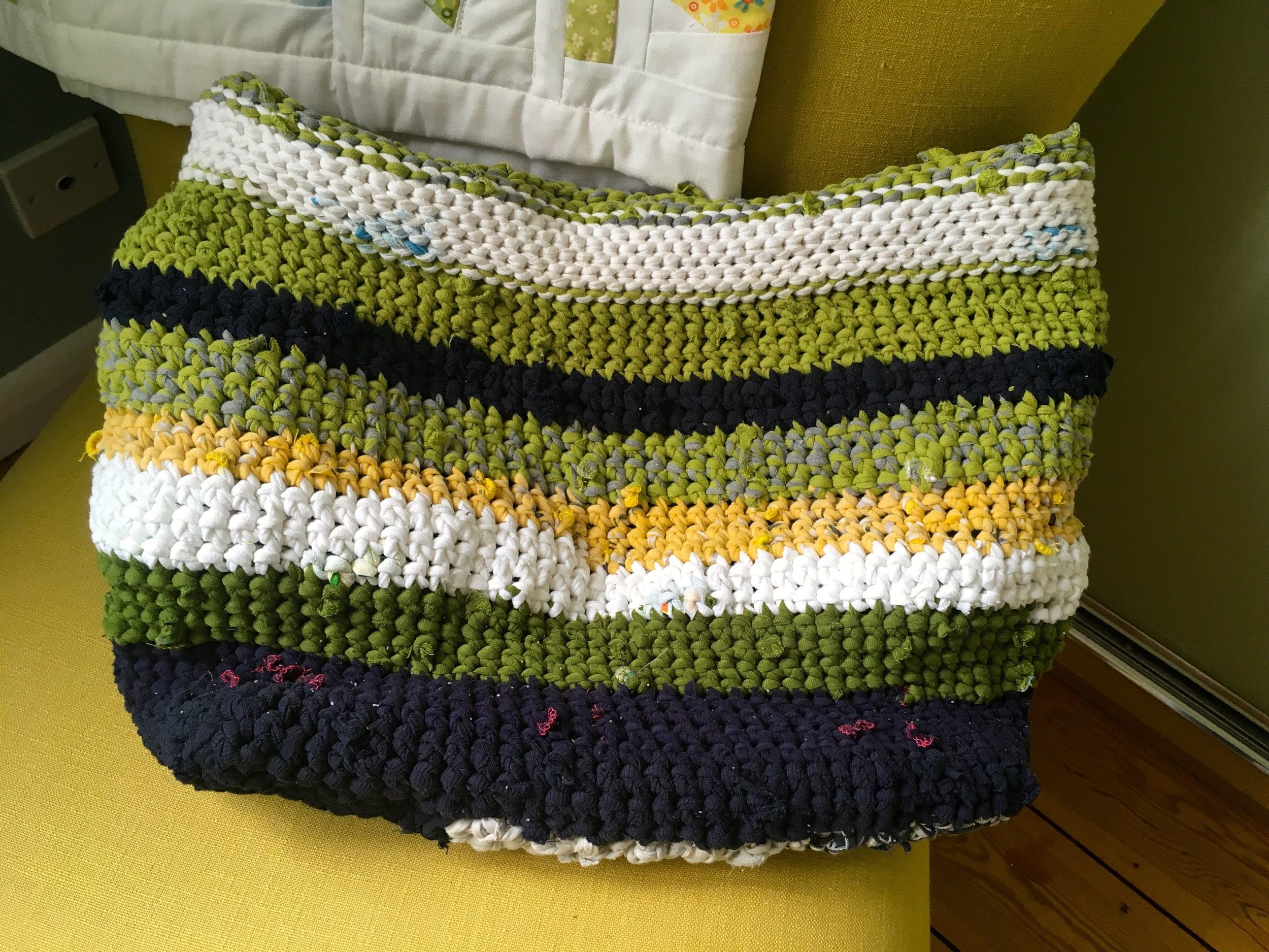 A completed crochet basket made from around 12 old t shirts
