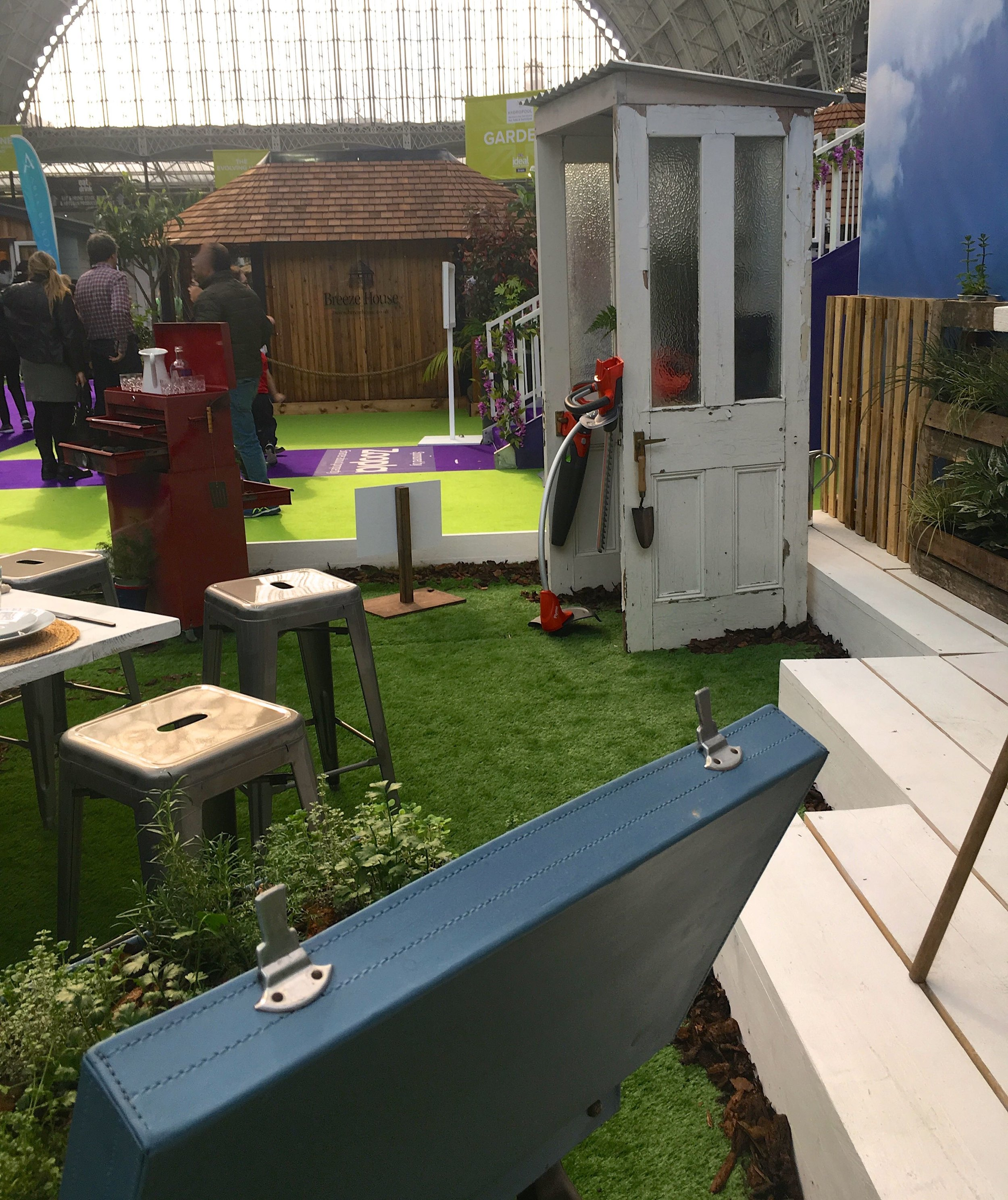 old doors and a suitcase put to good use in the Upcycled Garden at the Ideal Home Show