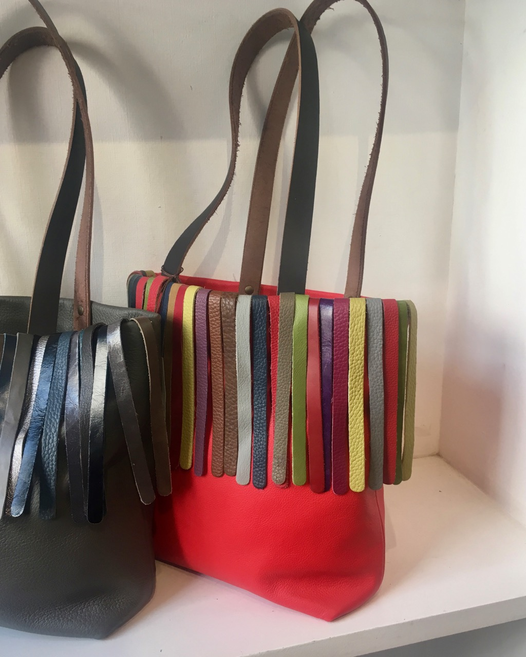 fringed leather totes