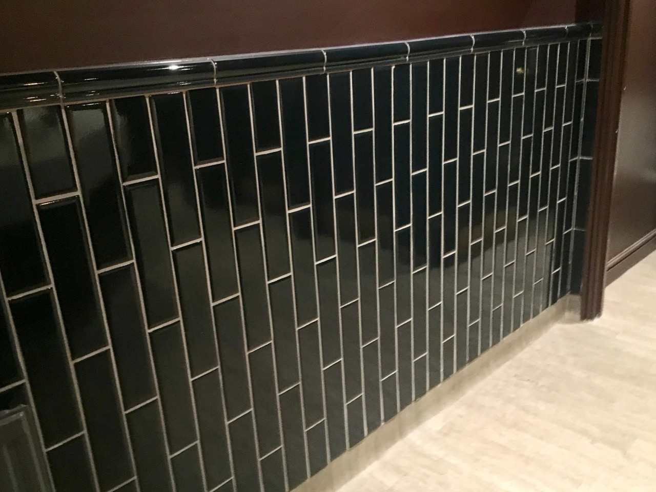 A gloriously dark tiled wall