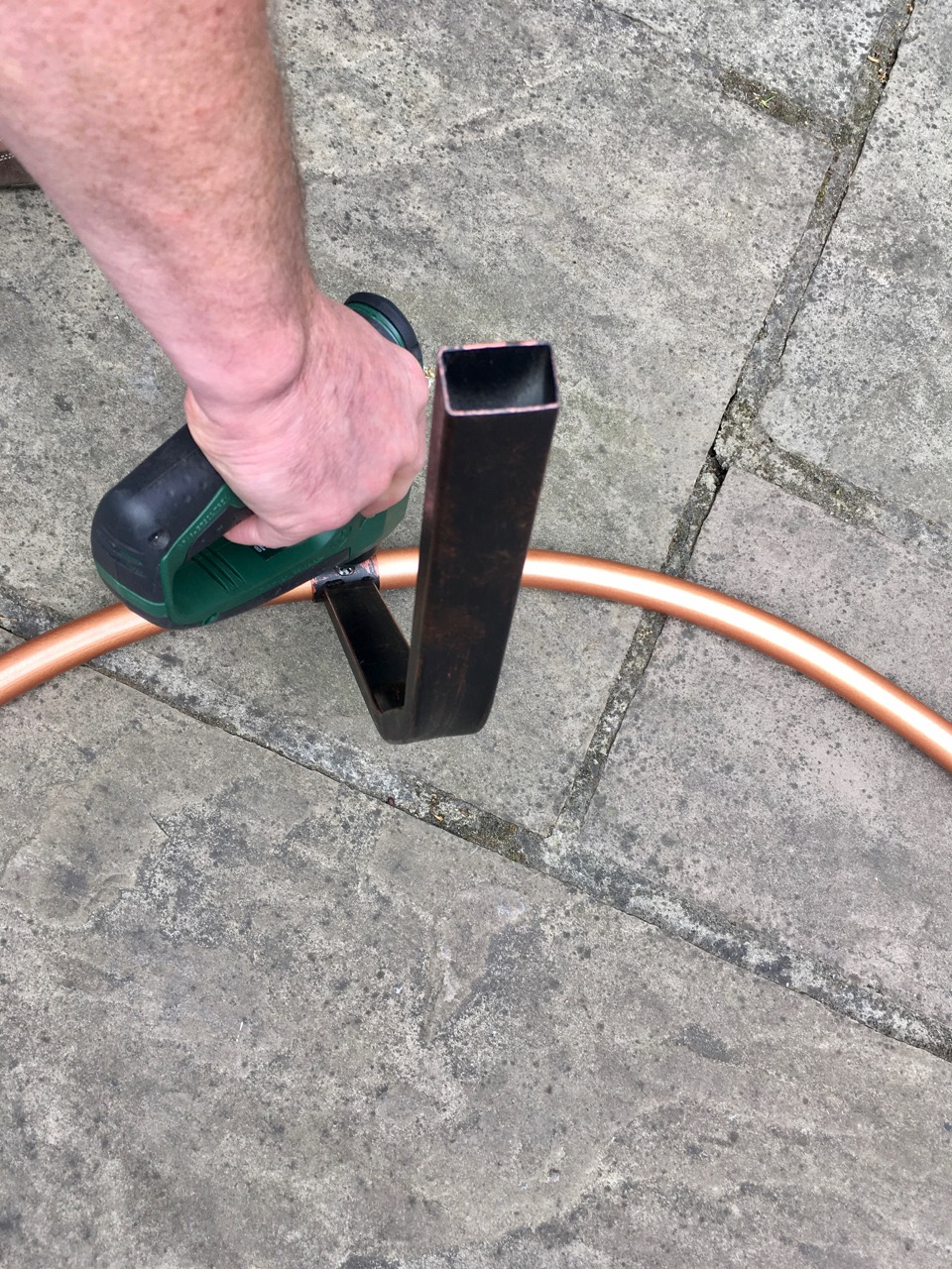 assembling the outer copper ring and attaching the legs