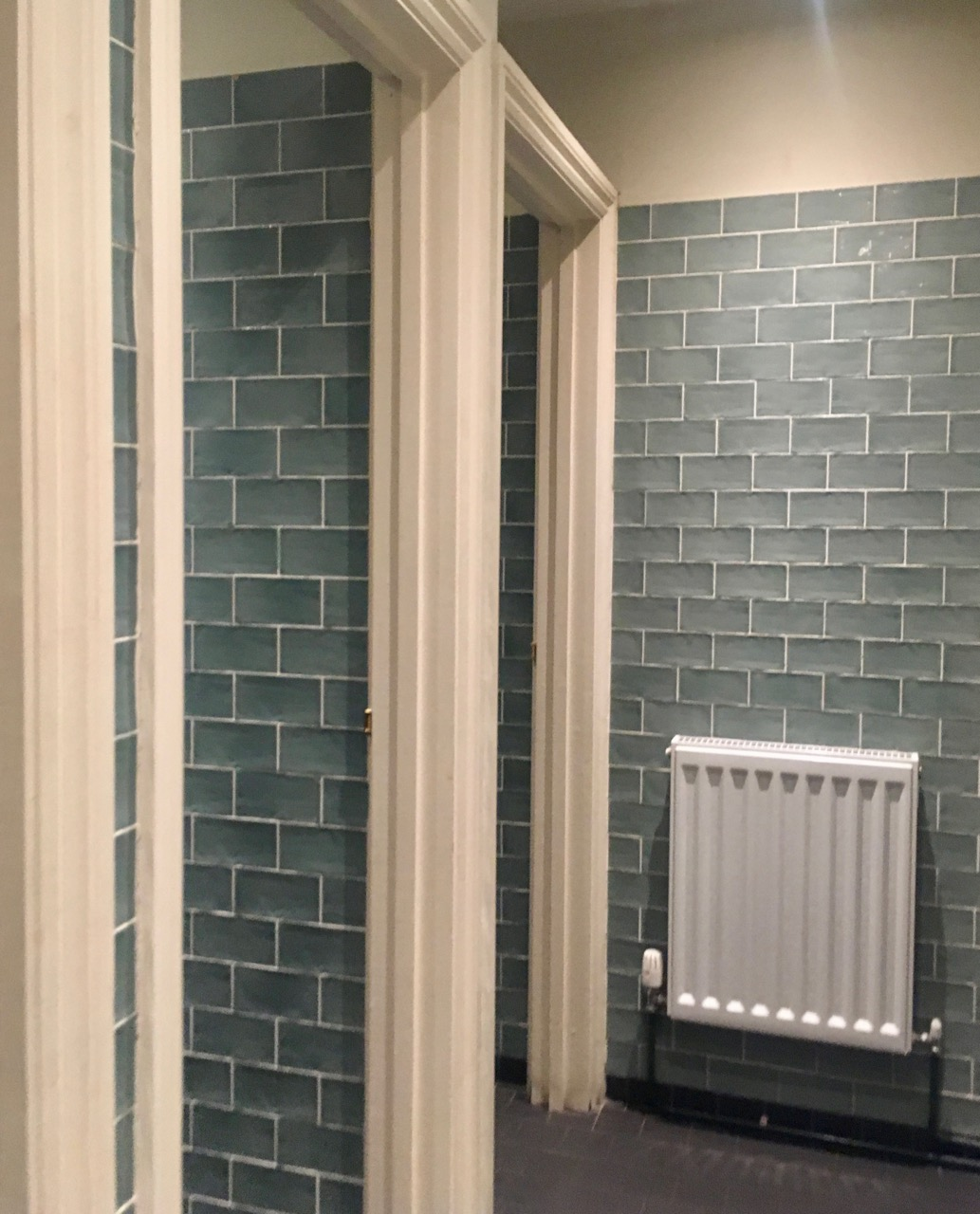 pale green tiles in the loos at the Curious Pig