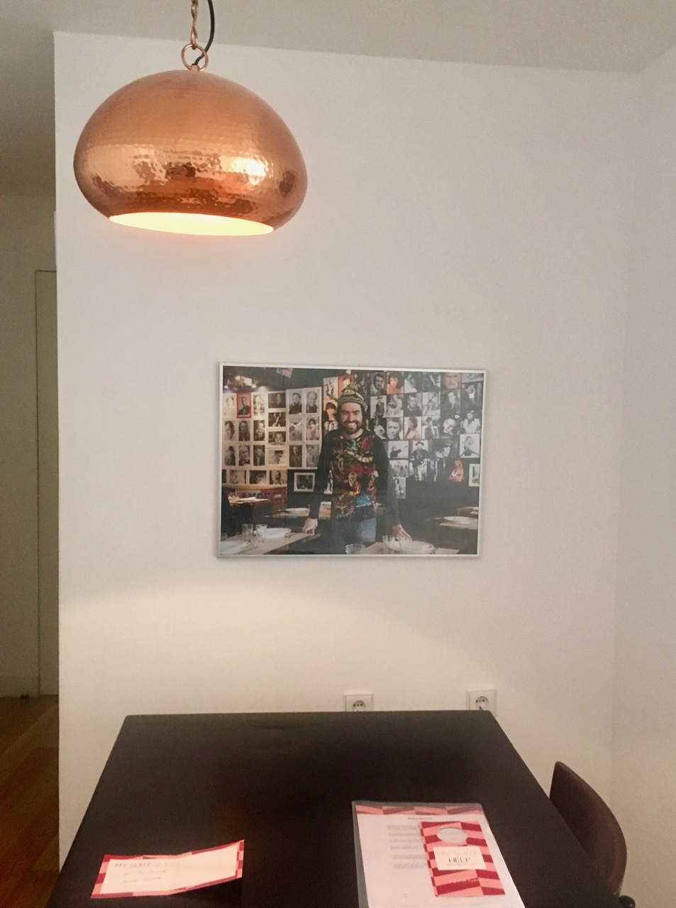 A copper light above the table.jpg