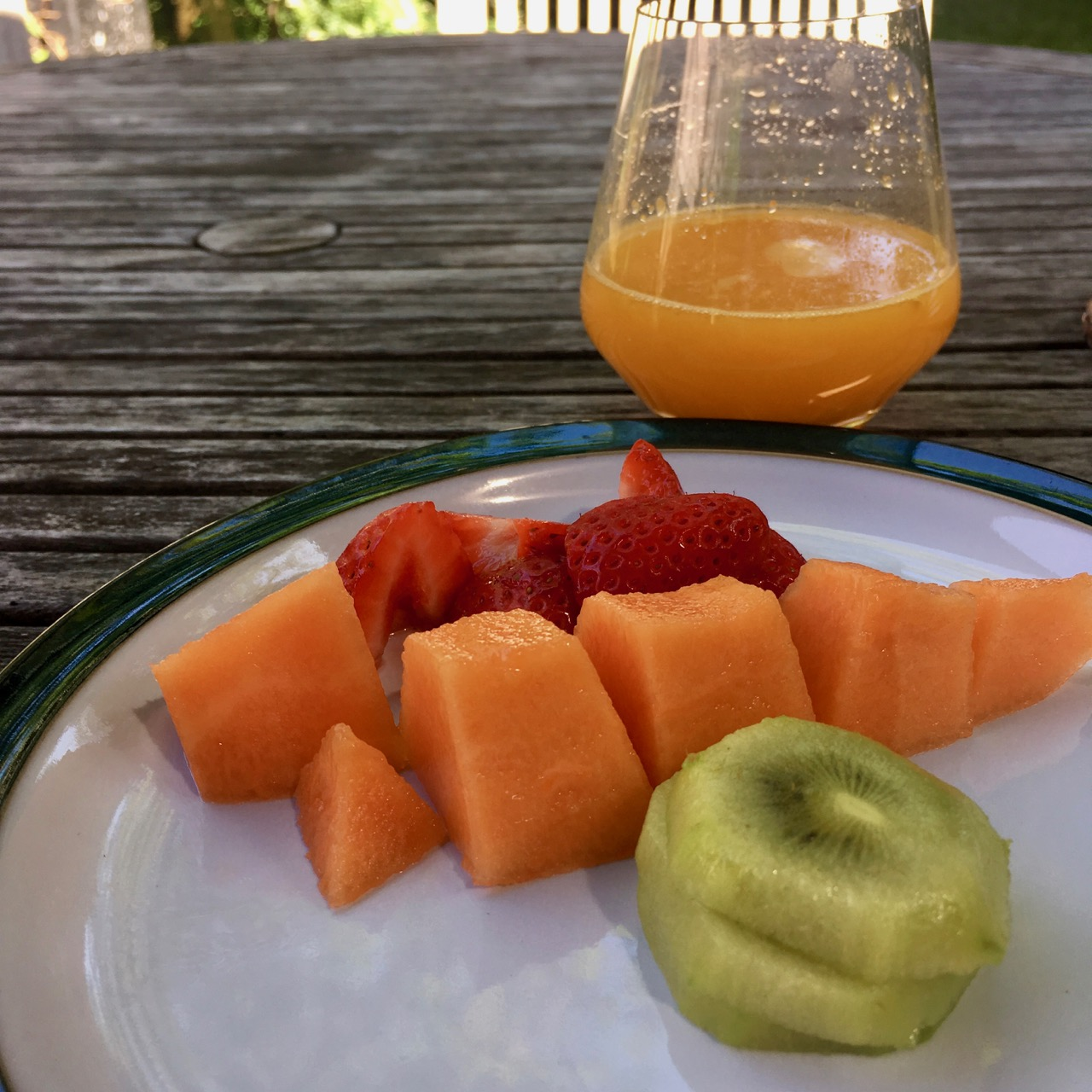 A colourful and healthy breakfast in the garden
