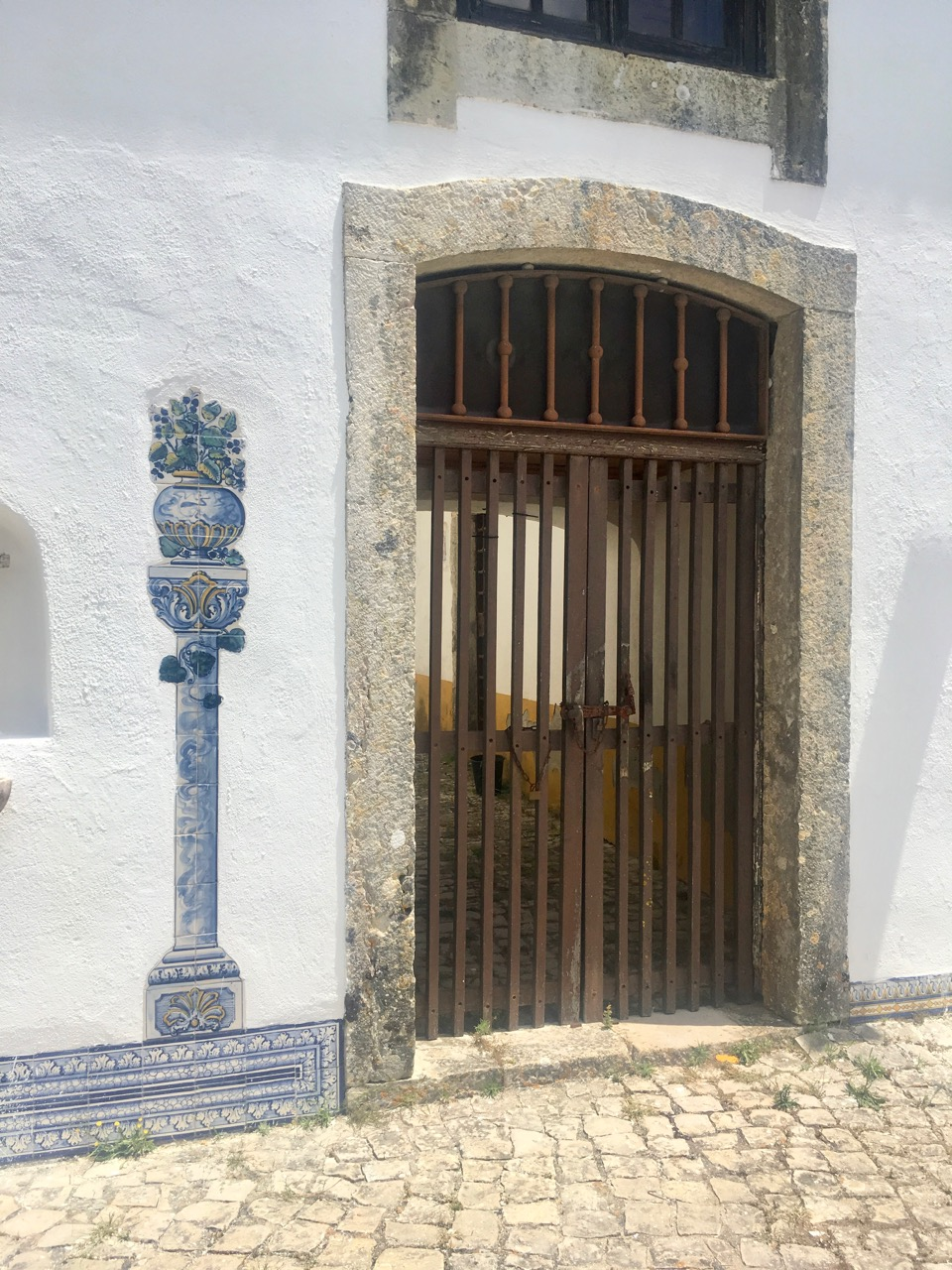 Beautifully stylish Azulejo tiles, and a rather functional gate by comparison.