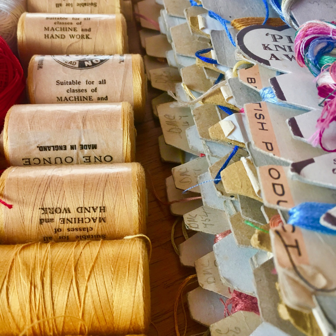 yellow thread and embroidery threads on cards