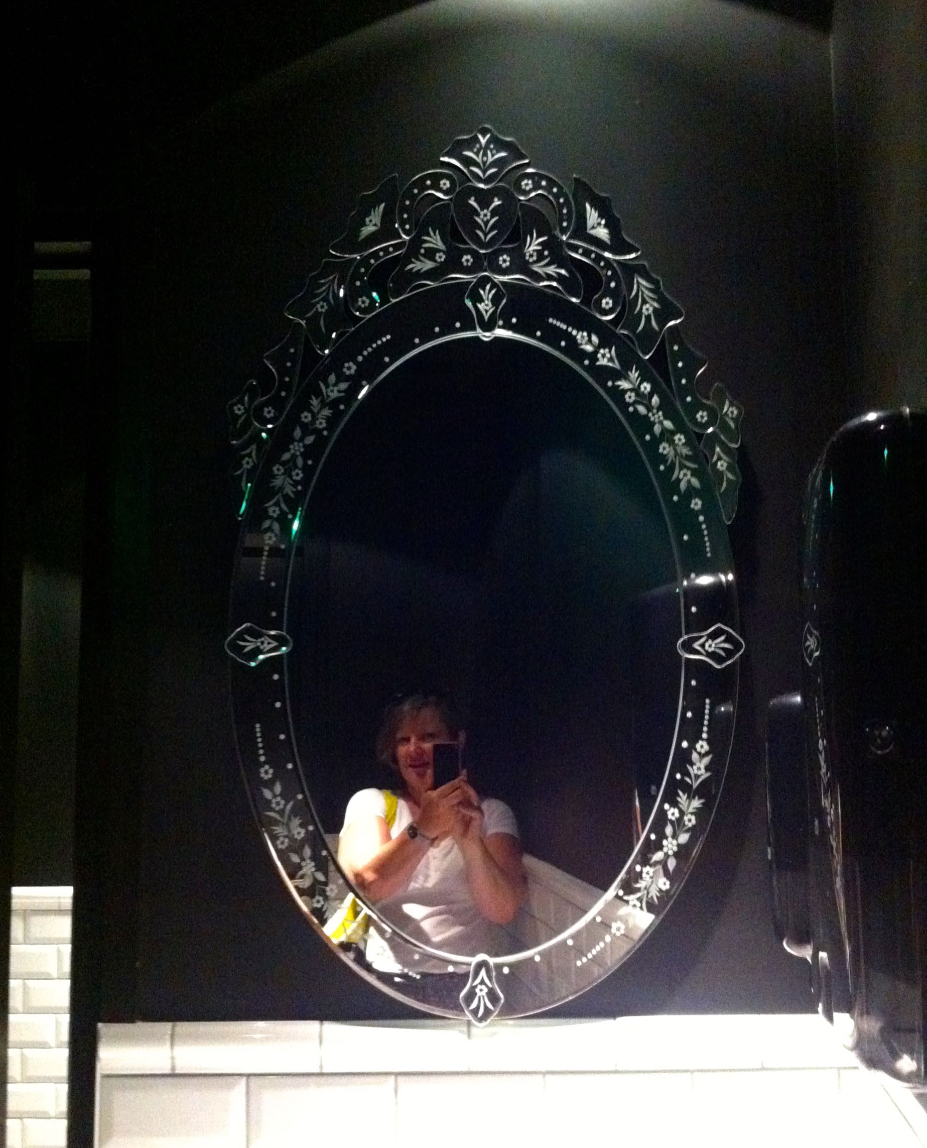 A fancy mirror totally in keeping with the theme