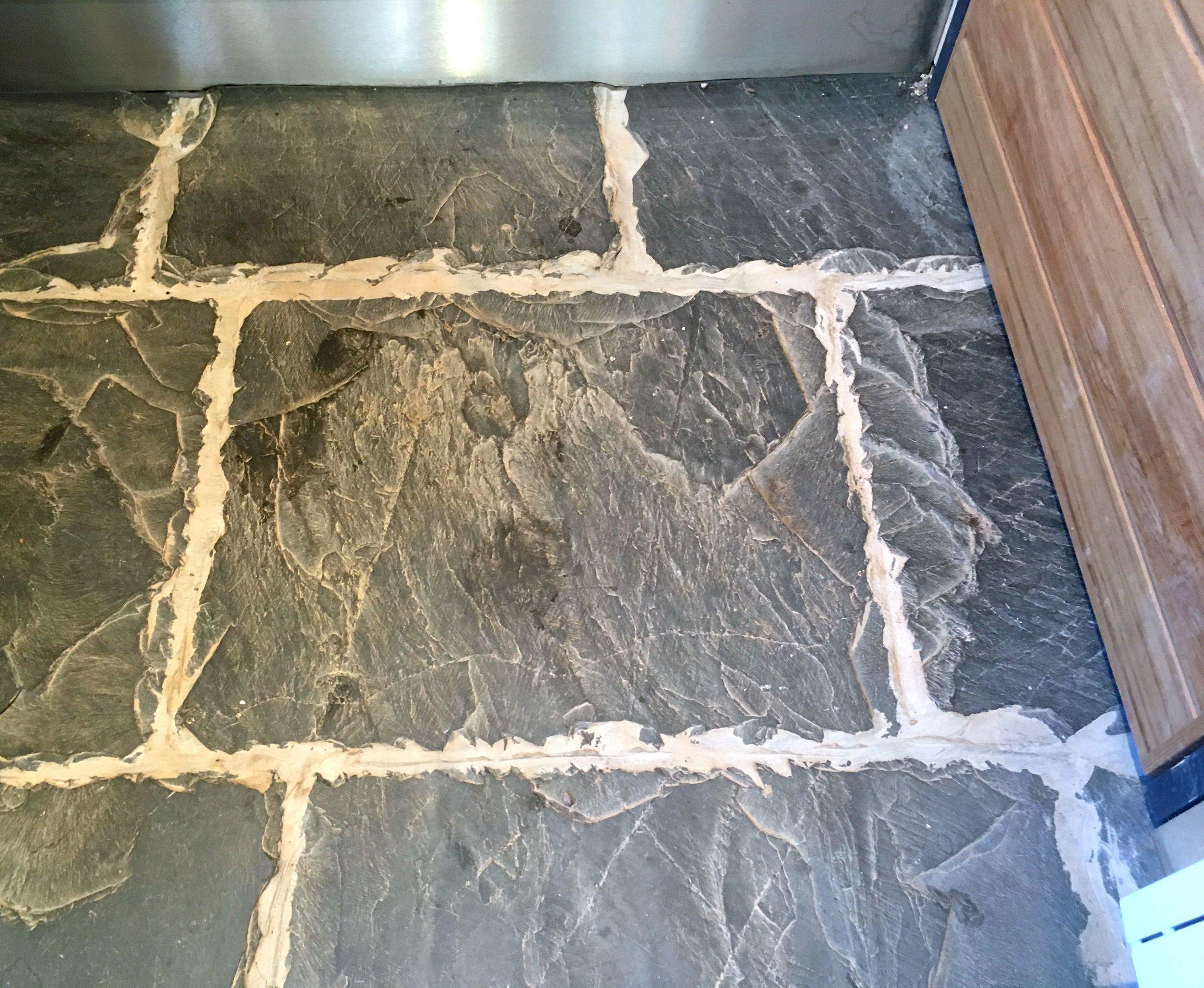 rustic tiled floor at NT Killerton garden loos