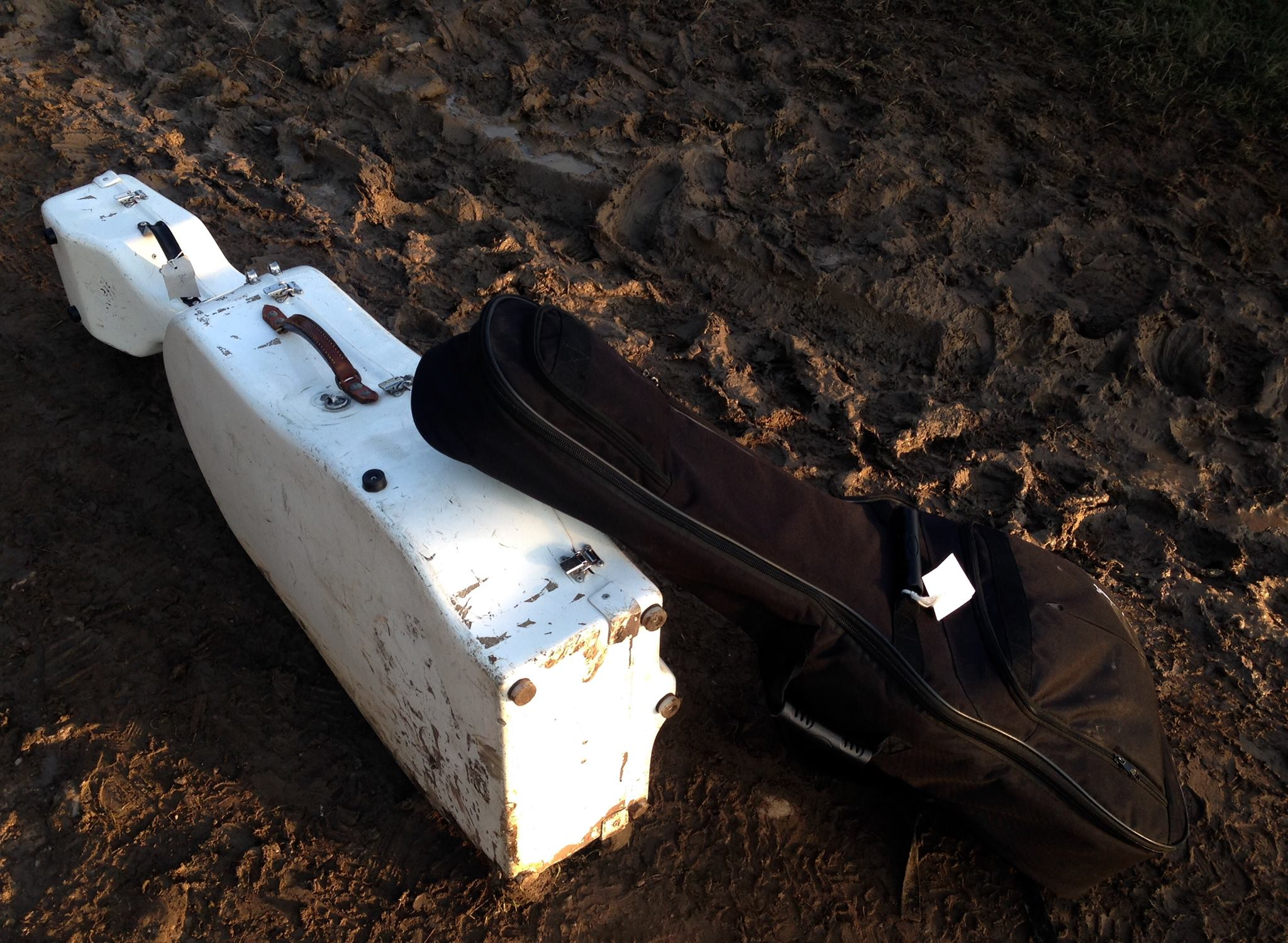 Cello and guitar resting in the mud