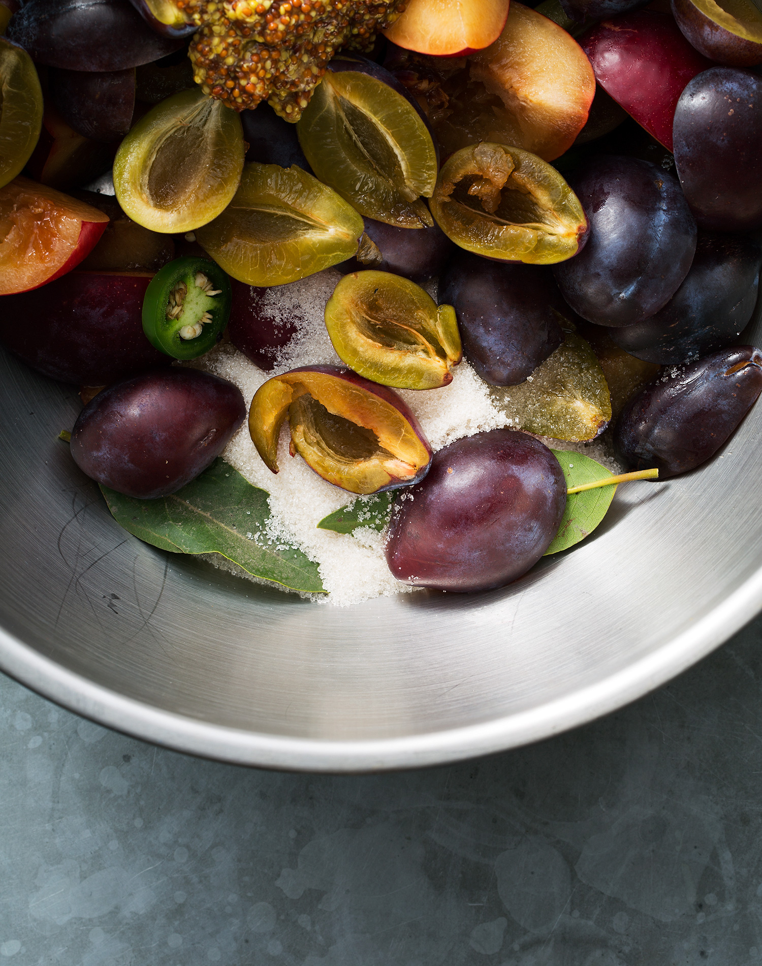 cut plums with jalepeno sugar and bay leaves