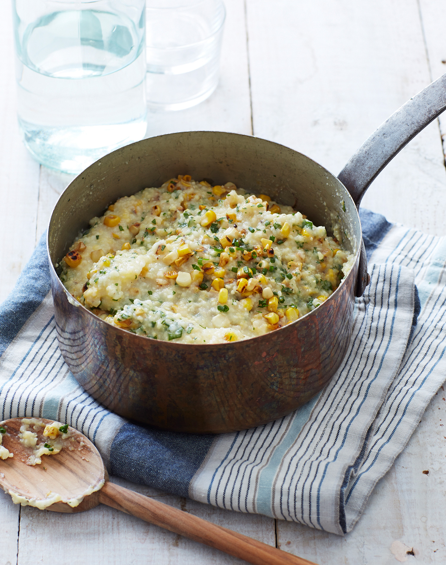 polenta with fresh corn and herbs in pot
