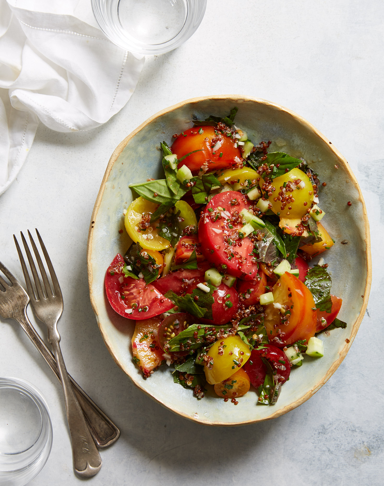 tomato salad with yellow plum, sesame leaf, shiso and fresh basil  Prop styling by Nidia Cueva